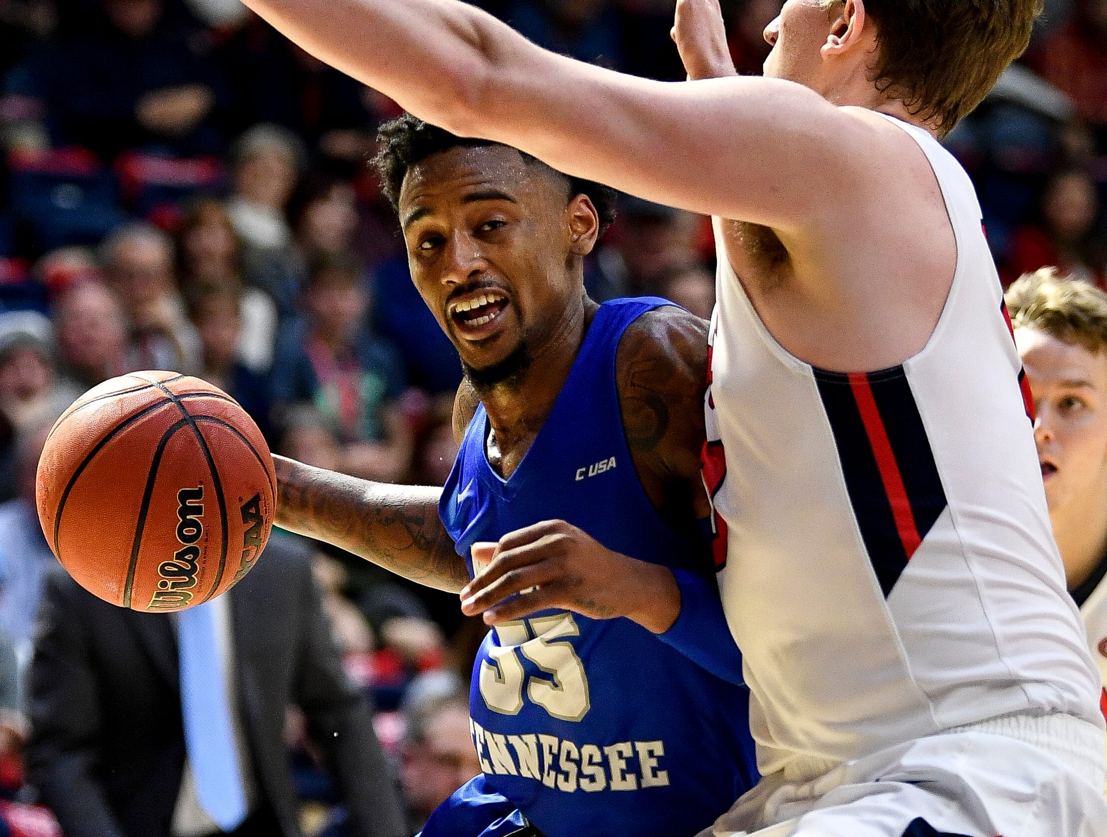 MTSU guard Antonio Green (55) is guarded by Belmont forward Caleb Hollander (10) during the second half at the Curb Event Center Arena in Nashville, Tenn., Monday, Nov. 12, 2018.