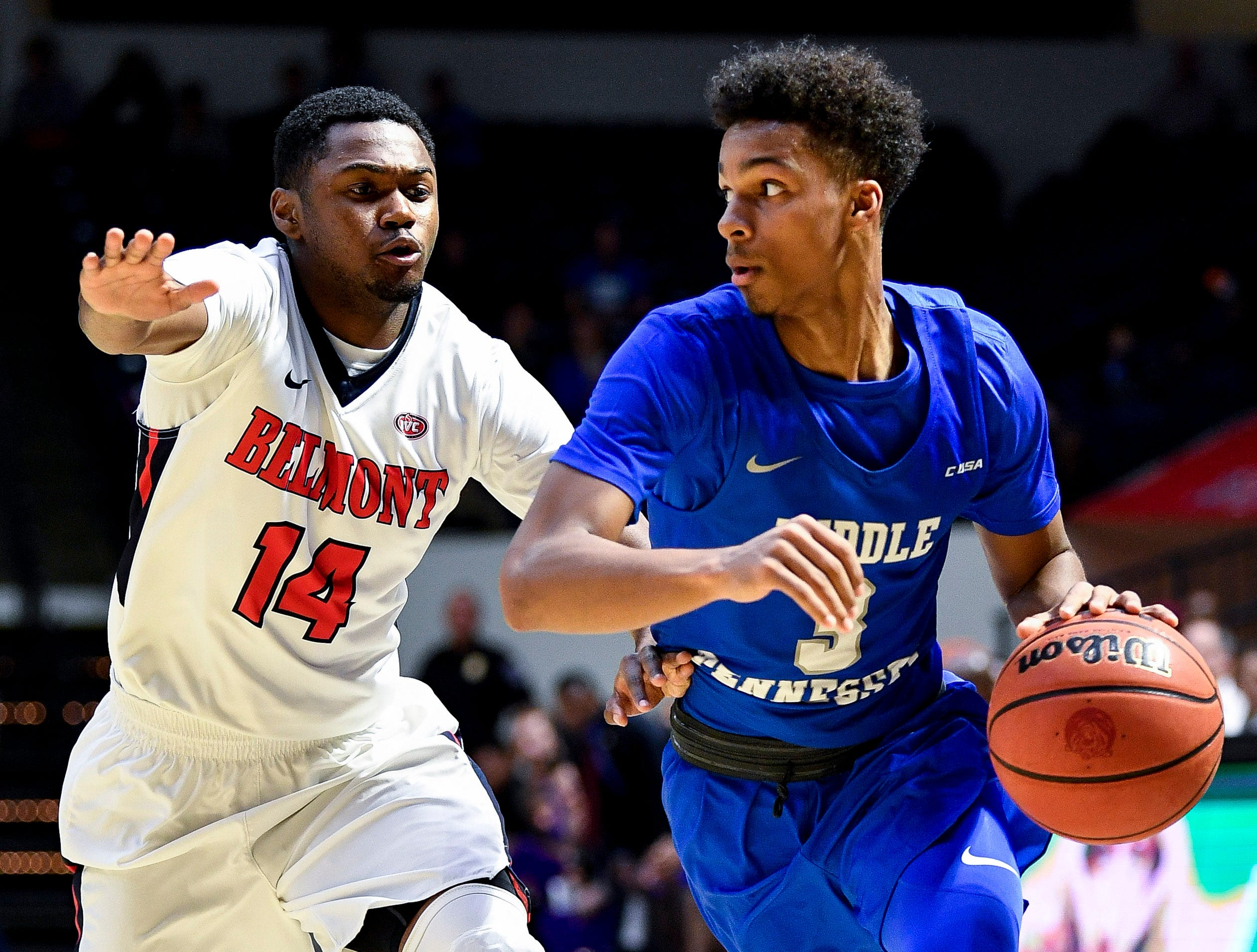 MTSU guard Donovan Sims (3) advances past Belmont guard Nick Hopkins (14) during the first half at the Curb Event Center Arena in Nashville, Tenn., Monday, Nov. 12, 2018.