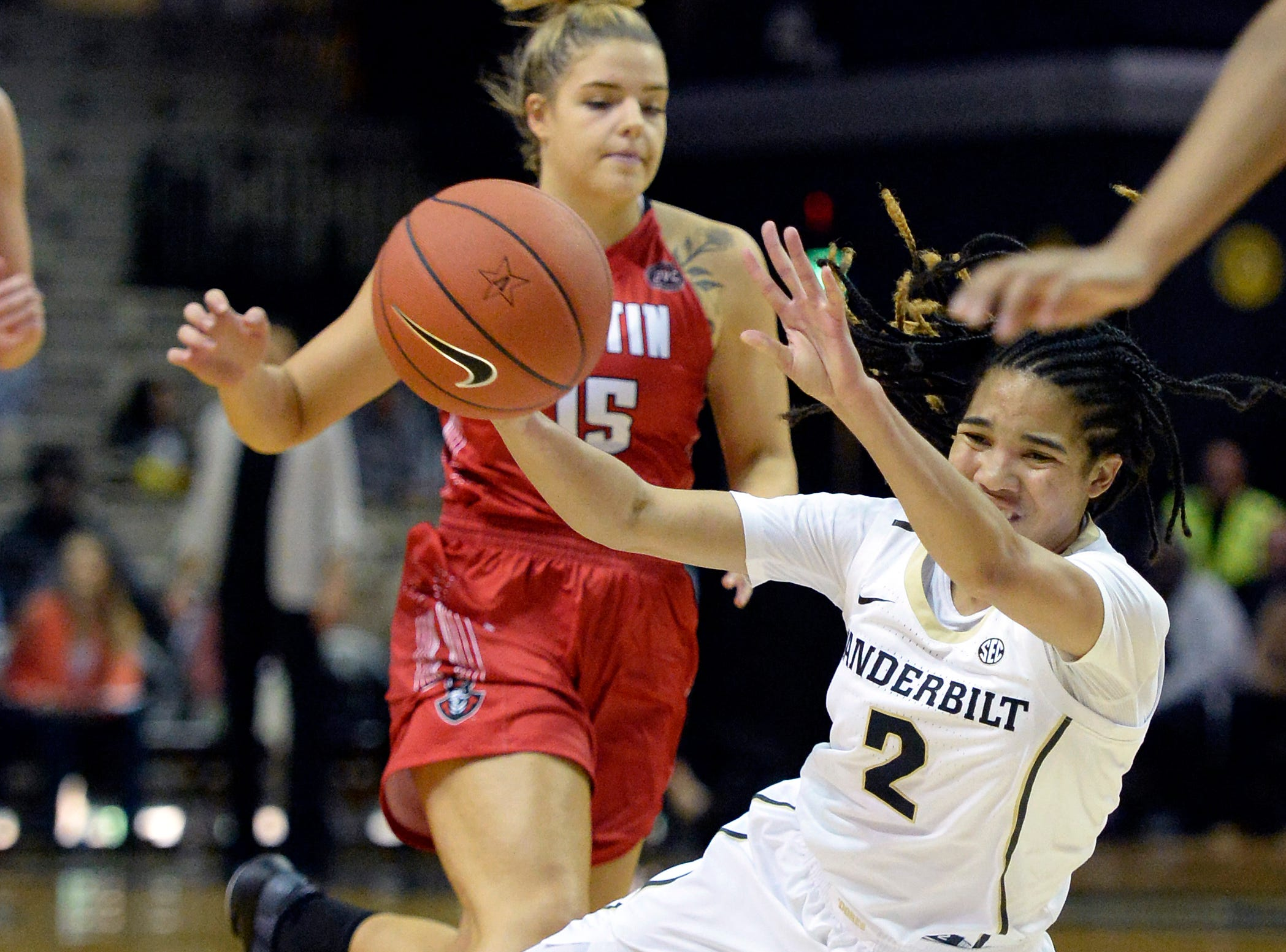 Austin Peay guard Kasey Kidwell (15) fouls Vanderbilt guard Chelsie Hall (2) from behind during the first half of an NCAA college basketball game Monday, Nov. 12, 2018, in Nashville, Tenn.