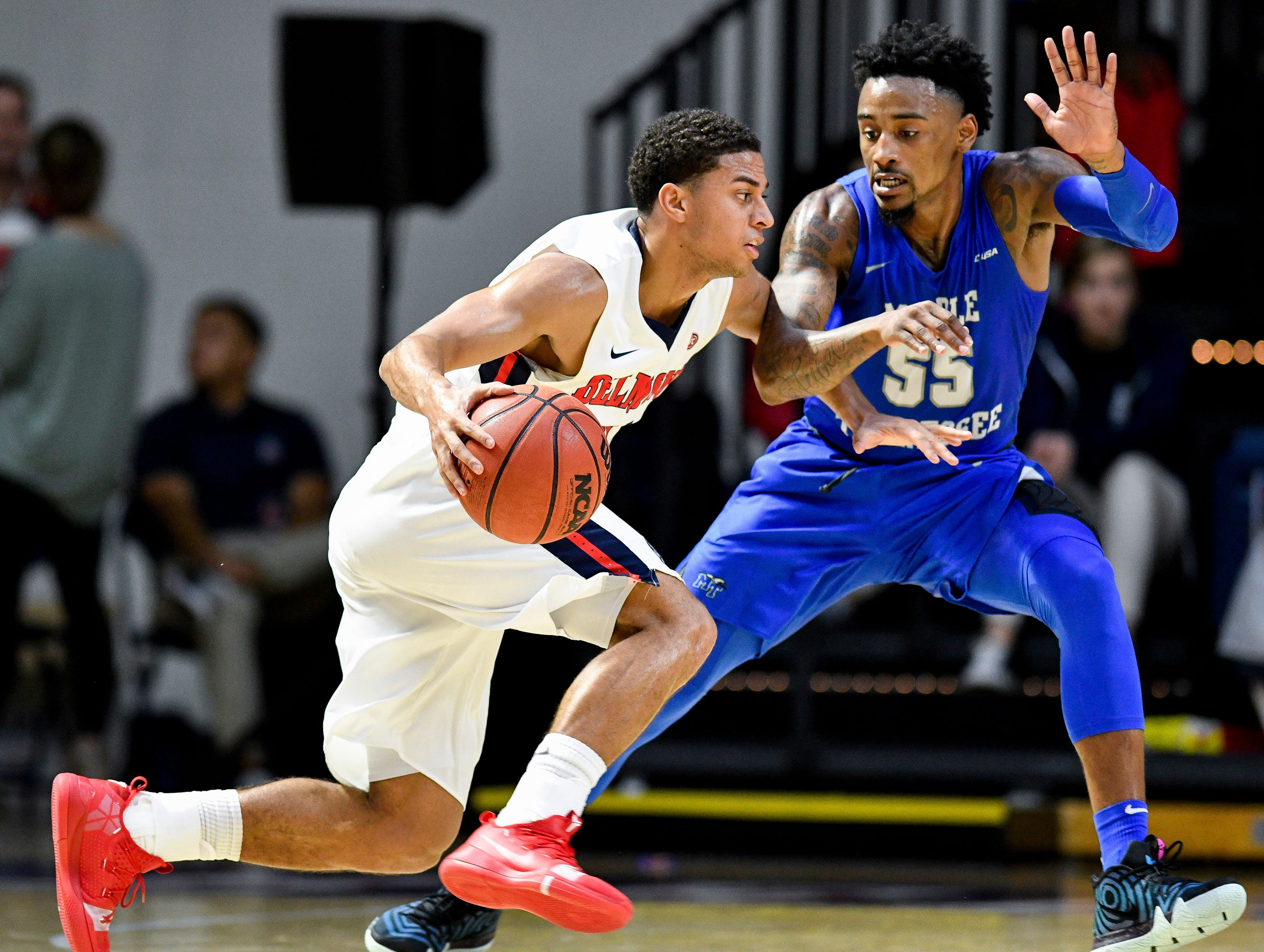 Belmont guard Kevin McClain (11) advances into MTSU guard Antonio Green (55) during the first half at the Curb Event Center Arena in Nashville, Tenn., Monday, Nov. 12, 2018.