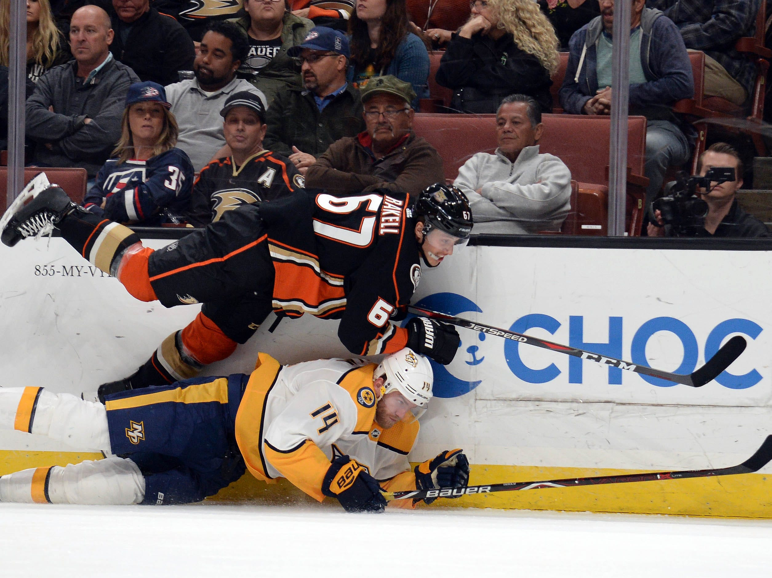 November 12, 2018; Anaheim, CA, USA; Anaheim Ducks center Rickard Rakell (67) plays for the puck against Nashville Predators defenseman Mattias Ekholm (14) during the second period at Honda Center.