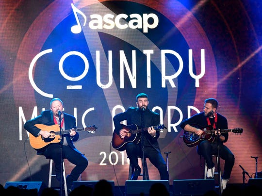 "Sam Hunt, center, and co-writers Zach Crowell and Josh Osborne performed their crossover, record-breaking hit, ""Body Like a Back Road,"" which was named ASCAP Country Music Song of the Year at the 2018 ASCAP Country Music Awards at the Renaissance Hotel