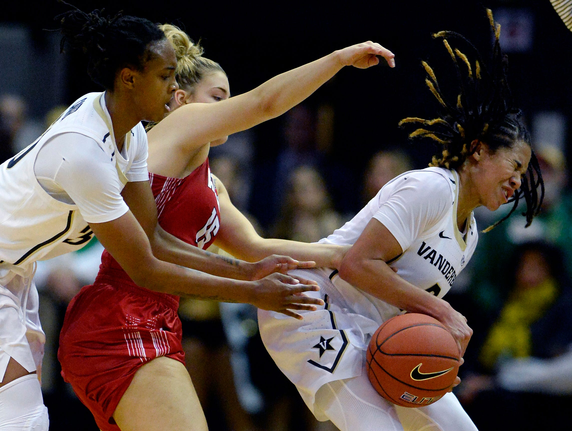 Vanderbilt guard Chelsie Hall, right, is fouled by Austin Peay guard Kasey Kidwell (15) during the second half of an NCAA college basketball game Monday, Nov. 12, 2018, in Nashville, Tenn. Vanderbilt won 99-70.