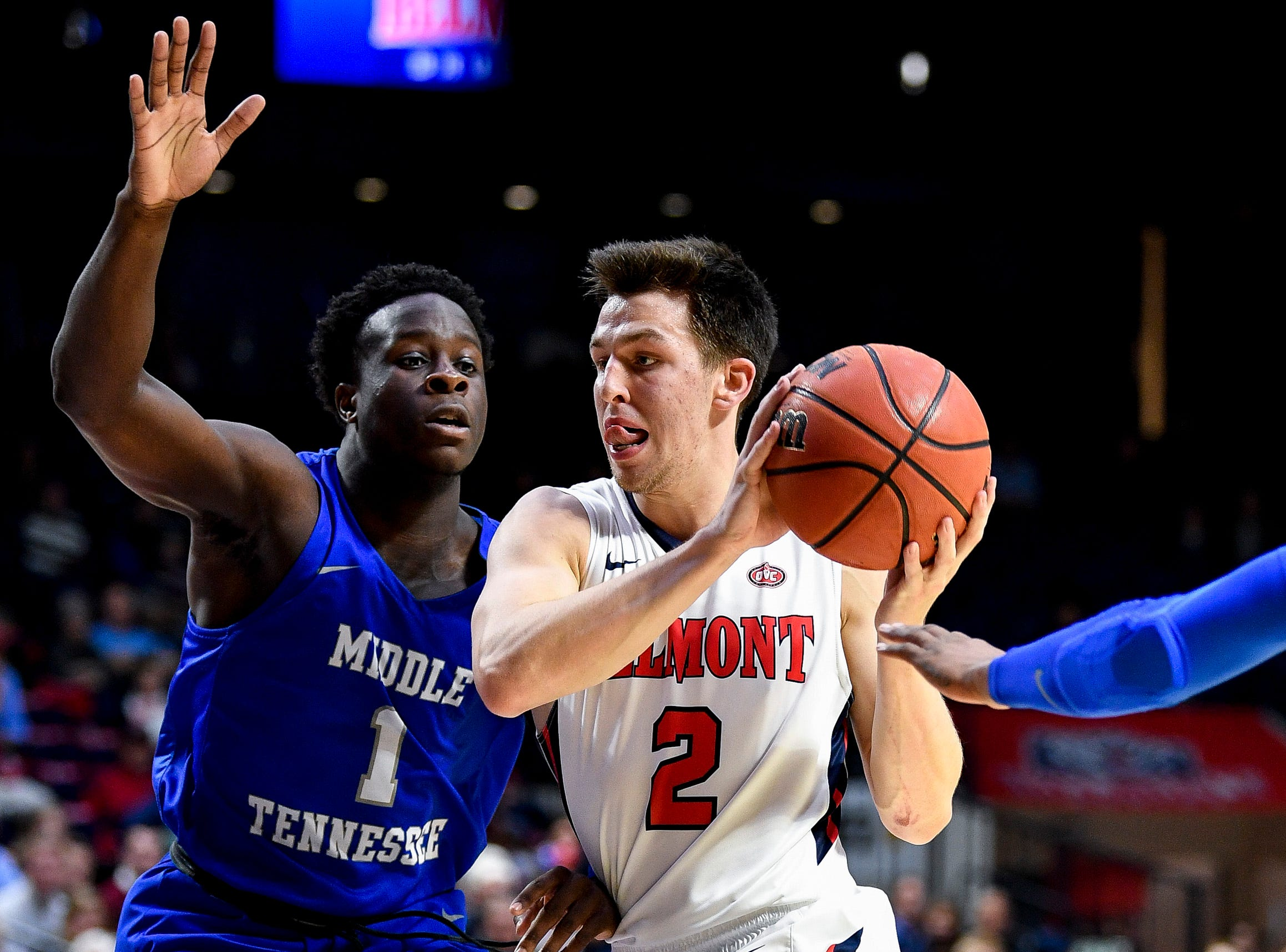 Belmont guard Grayson Murphy (2) advances into MTSU guard Junior Farquhar (1) during the first half at the Curb Event Center Arena in Nashville, Tenn., Monday, Nov. 12, 2018.
