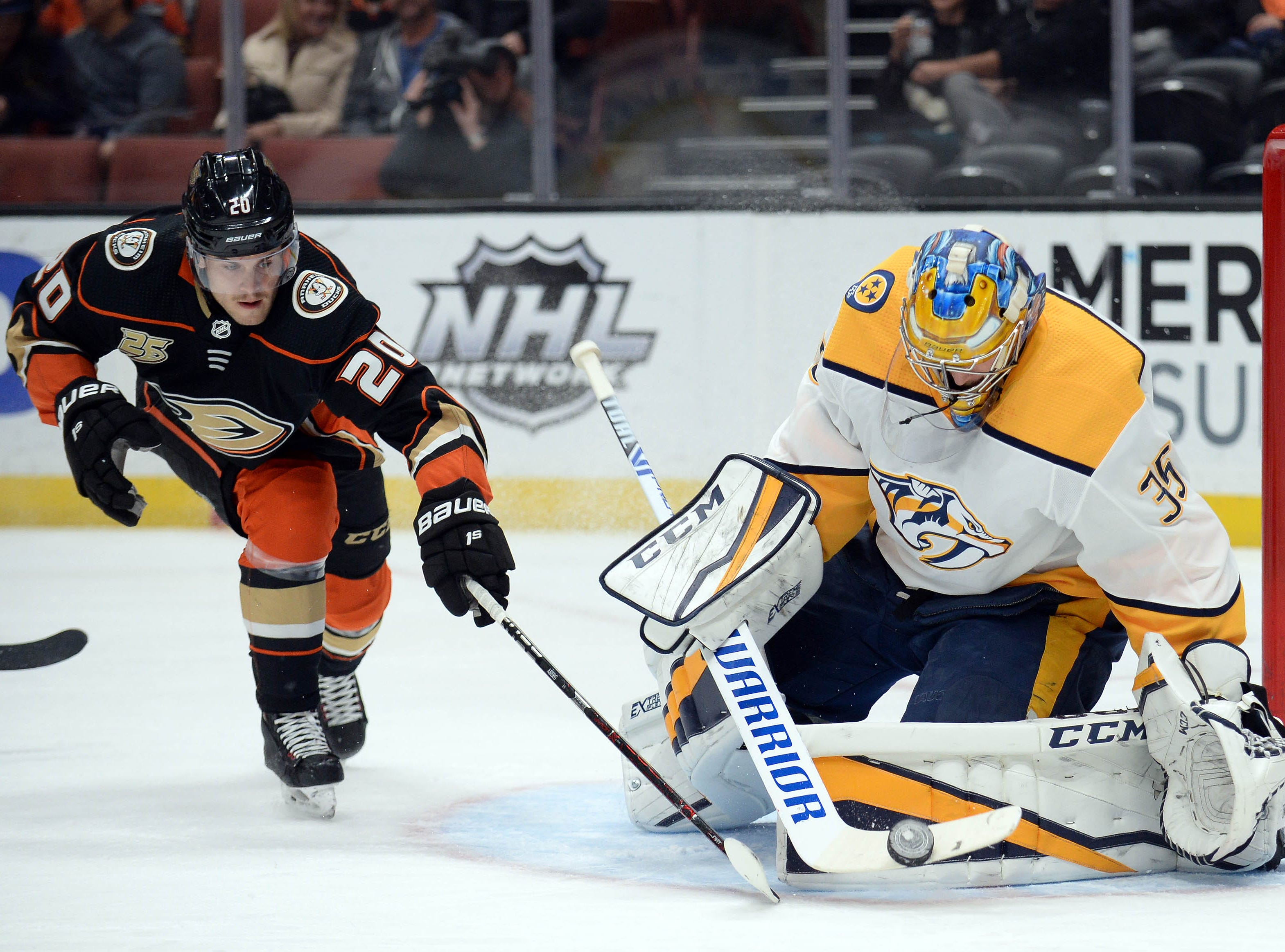 Nov. 12: Ducks 2, Predators 1 -- Anaheim Ducks left wing Pontus Aberg (20) moves in for the puck against Nashville Predators goaltender Pekka Rinne (35) during the second period at Honda Center.
