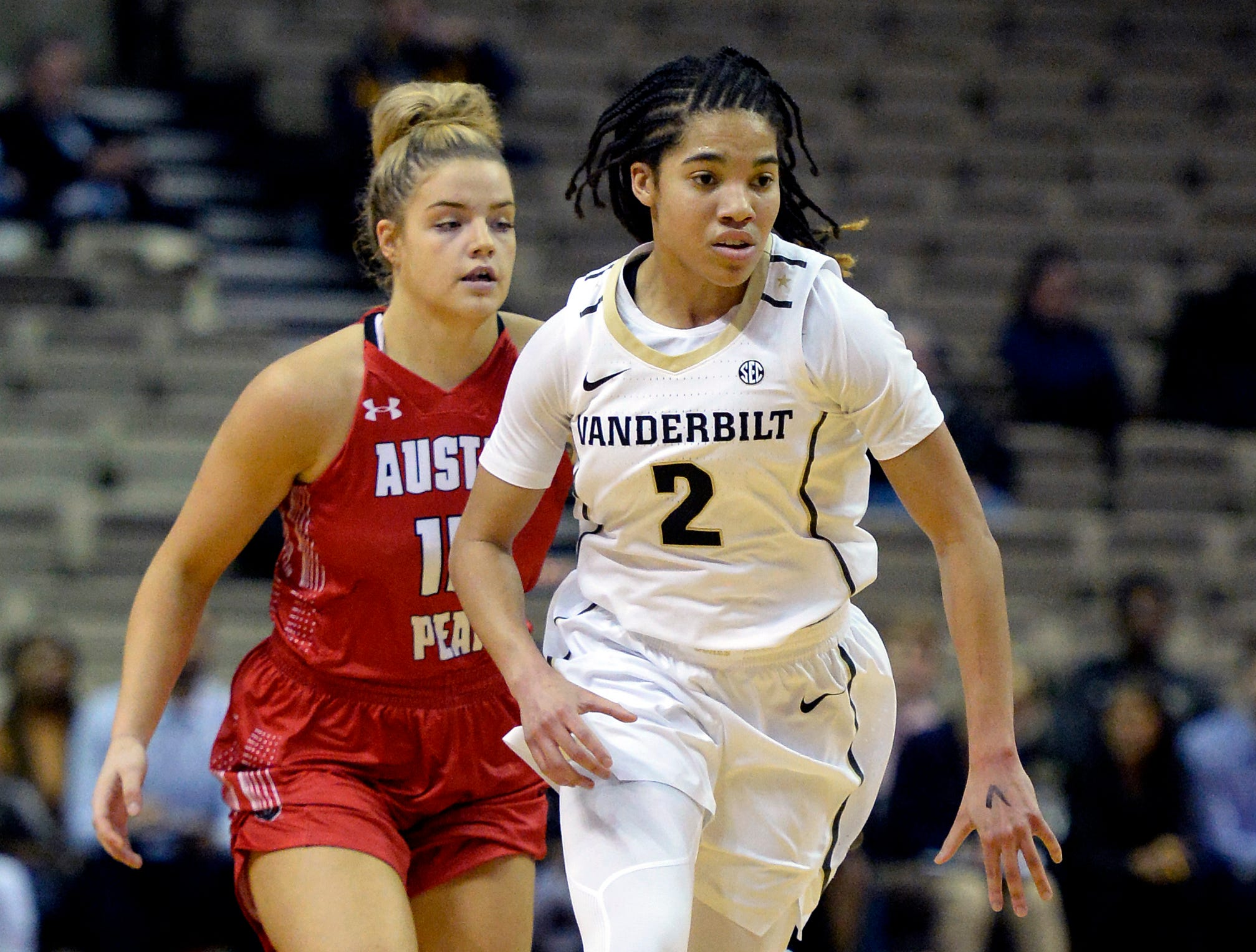 Vanderbilt guard Chelsie Hall (2) dribbles past Austin Peay guard Kasey Kidwell (15) during the first half of an NCAA college basketball game Monday, Nov. 12, 2018, in Nashville, Tenn.