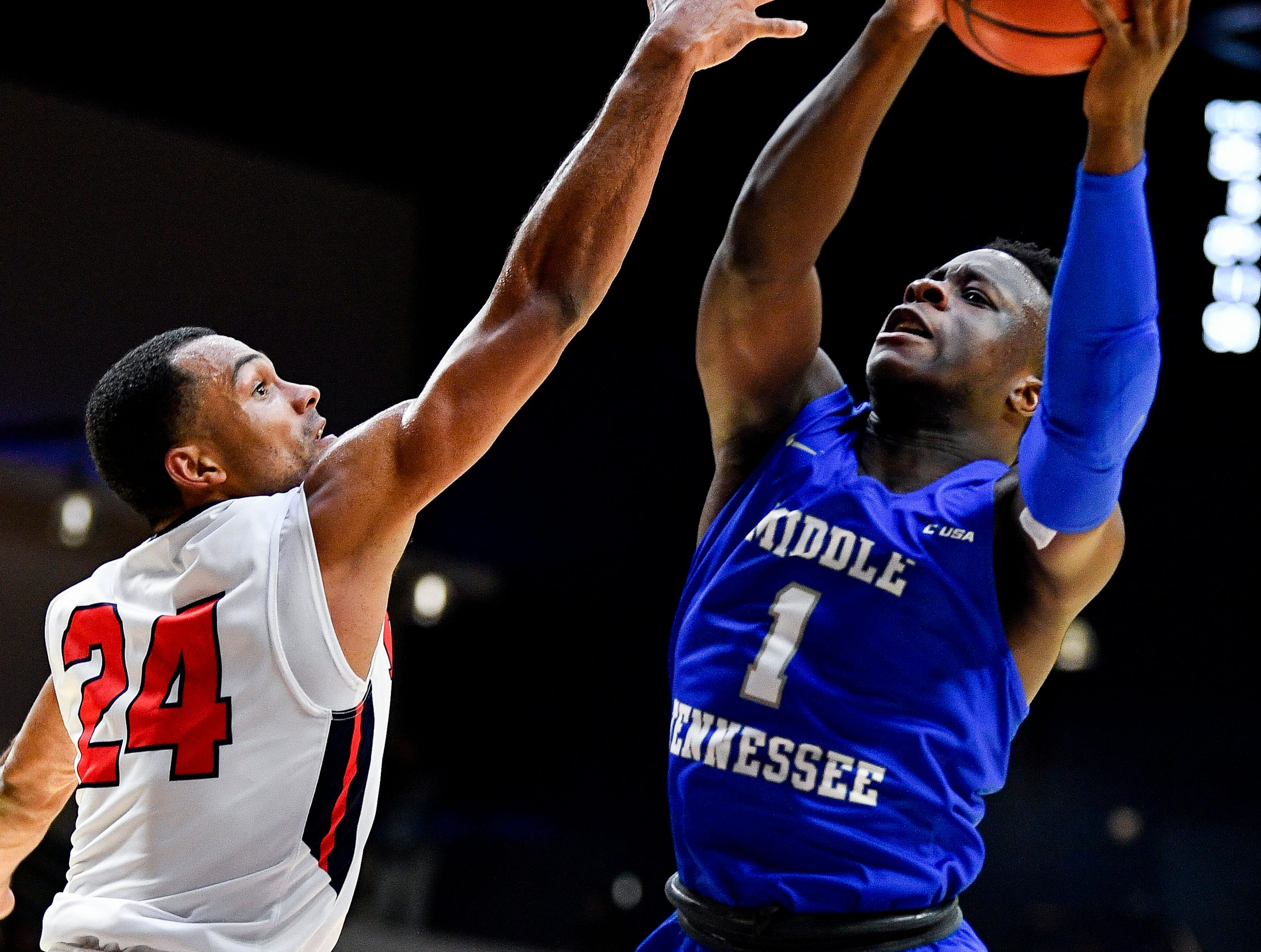 MTSU guard Junior Farquhar (1) battles Belmont guard Michael Benkert (24) during the first half at the Curb Event Center Arena in Nashville, Tenn., Monday, Nov. 12, 2018.