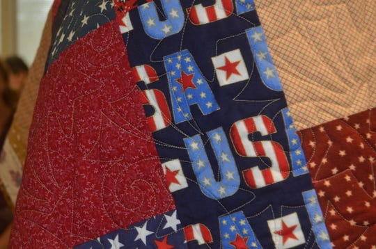 The Lakeshore Quilters Guild in Hendersonville used patriotic materials to make Quilts of Valor for veterans.