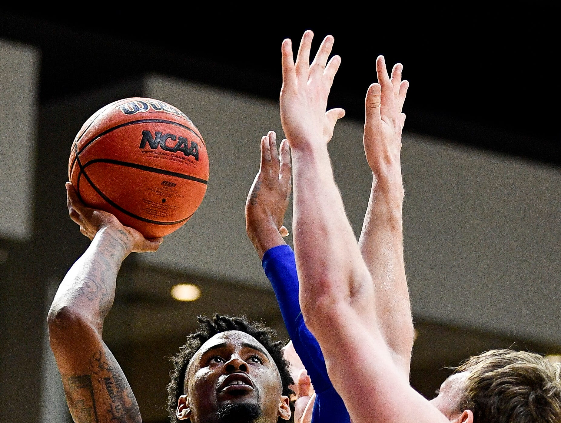 MTSU guard Antonio Green (55) shoots over Belmont forward Caleb Hollander (10) during the second half at the Curb Event Center Arena in Nashville, Tenn., Monday, Nov. 12, 2018.