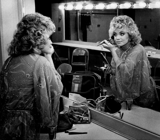 ABC recording star Barbara Mandrell makes certain everything is good before entertaining the crowd of dee jays and fans at Municipal Auditorium Oct. 20, 1978. Mandrell was the final act of the ABC Records luncheon and show.