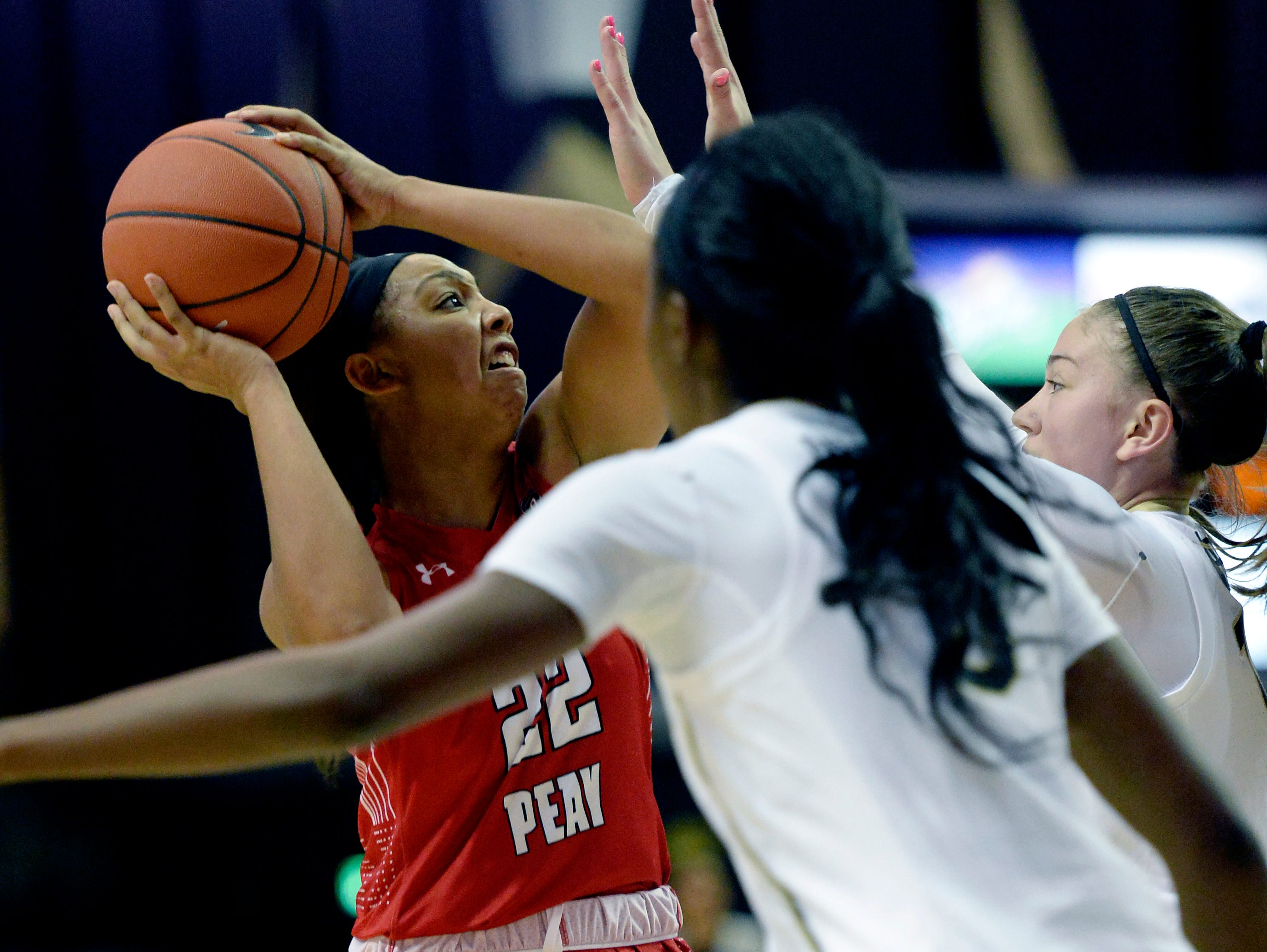 Austin Peay guard Keisha Gregory (22) looks to pass as she is defended Vanderbilt guard Cierra Walker, right, during the second half of an NCAA college basketball game Monday, Nov. 12, 2018, in Nashville, Tenn. Vanderbilt won 99-70.