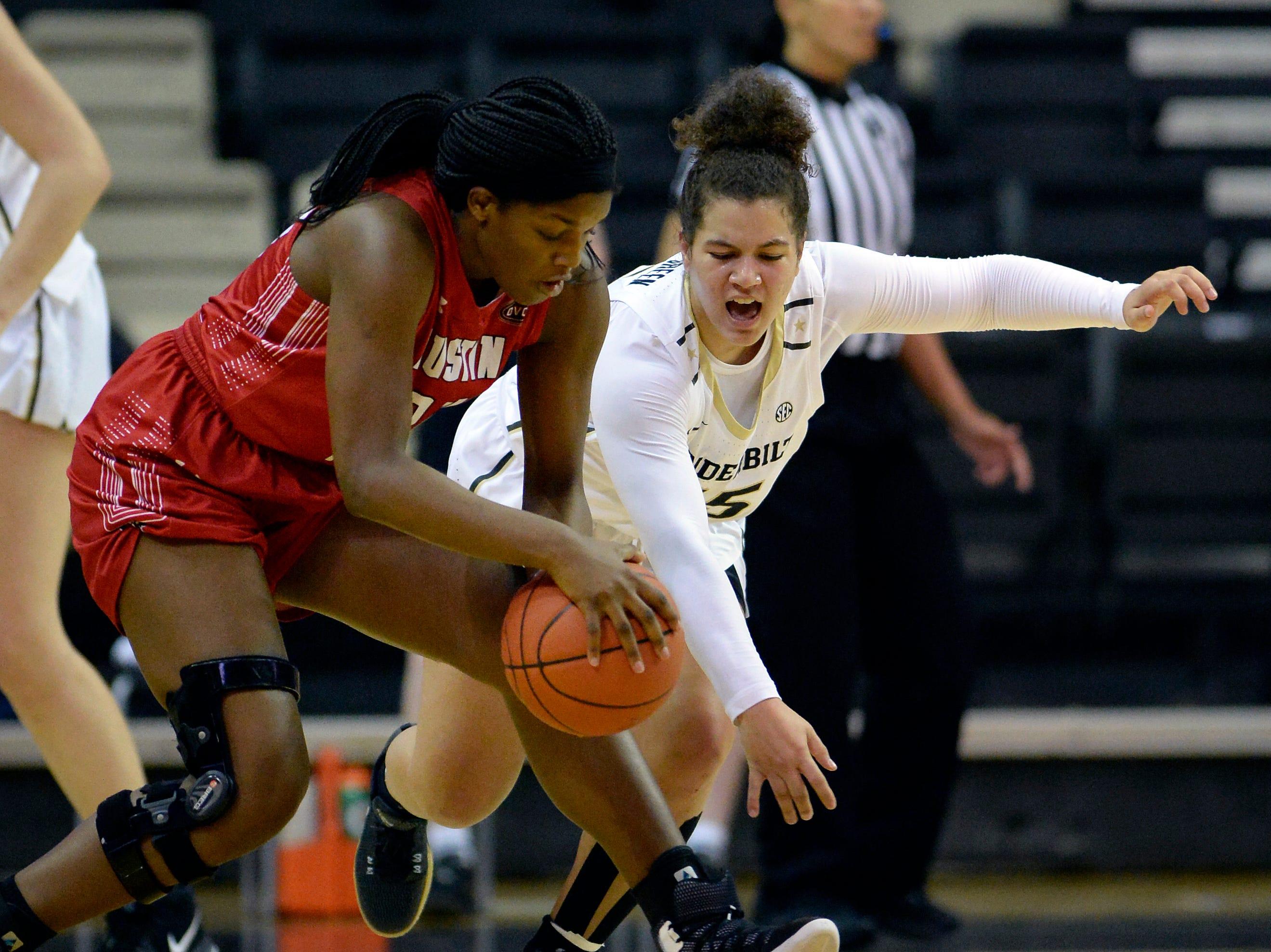 Austin Peay forward Kelen Kenol (24) is defended by Vanderbilt guard Kaleigh Clemons-Green (35) during the first half of an NCAA college basketball game Monday, Nov. 12, 2018, in Nashville, Tenn.