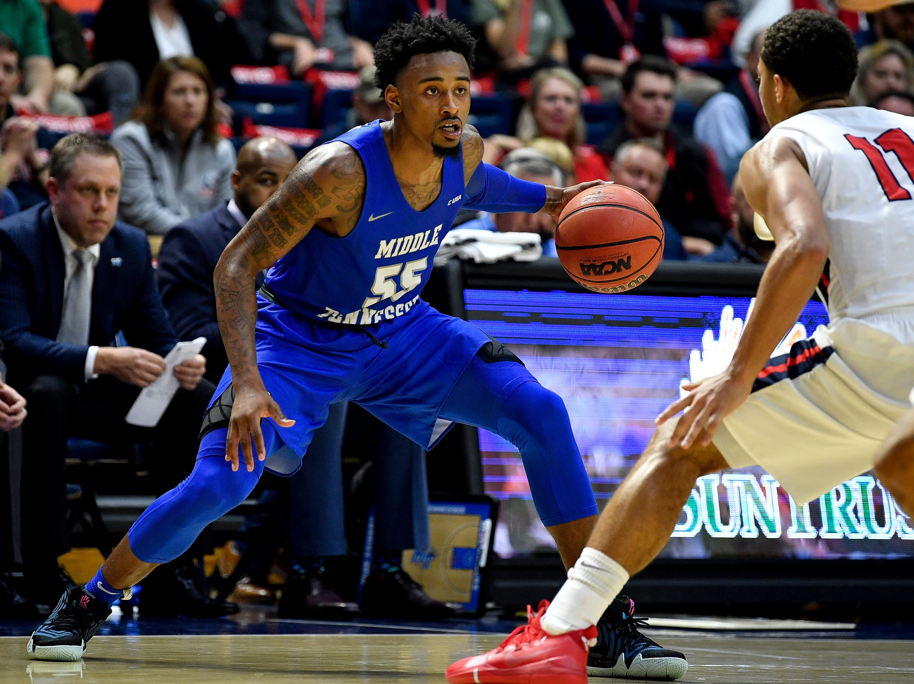MTSU guard Antonio Green (55) looks for an opening past Belmont guard Kevin McClain (11) during the second half at the Curb Event Center Arena in Nashville, Tenn., Monday, Nov. 12, 2018.