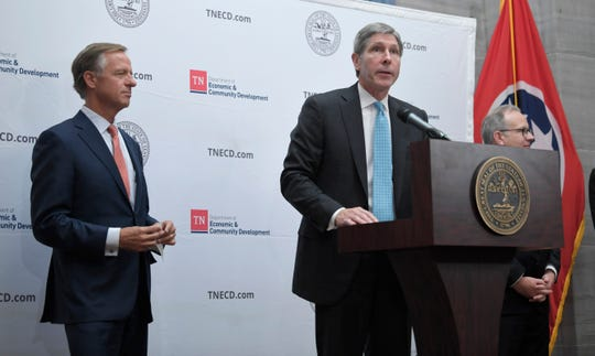 Tennessee economic development commission Bob Rolfe announces that Amazon is bringing its new operations site to Nashville, as Gov. Bill Haslam looks on, at a press conference at the Old Supreme Court Chamber in the Tennessee State Capitol Tuesday, Nov. 13, 2018, in Nashville, Tenn.