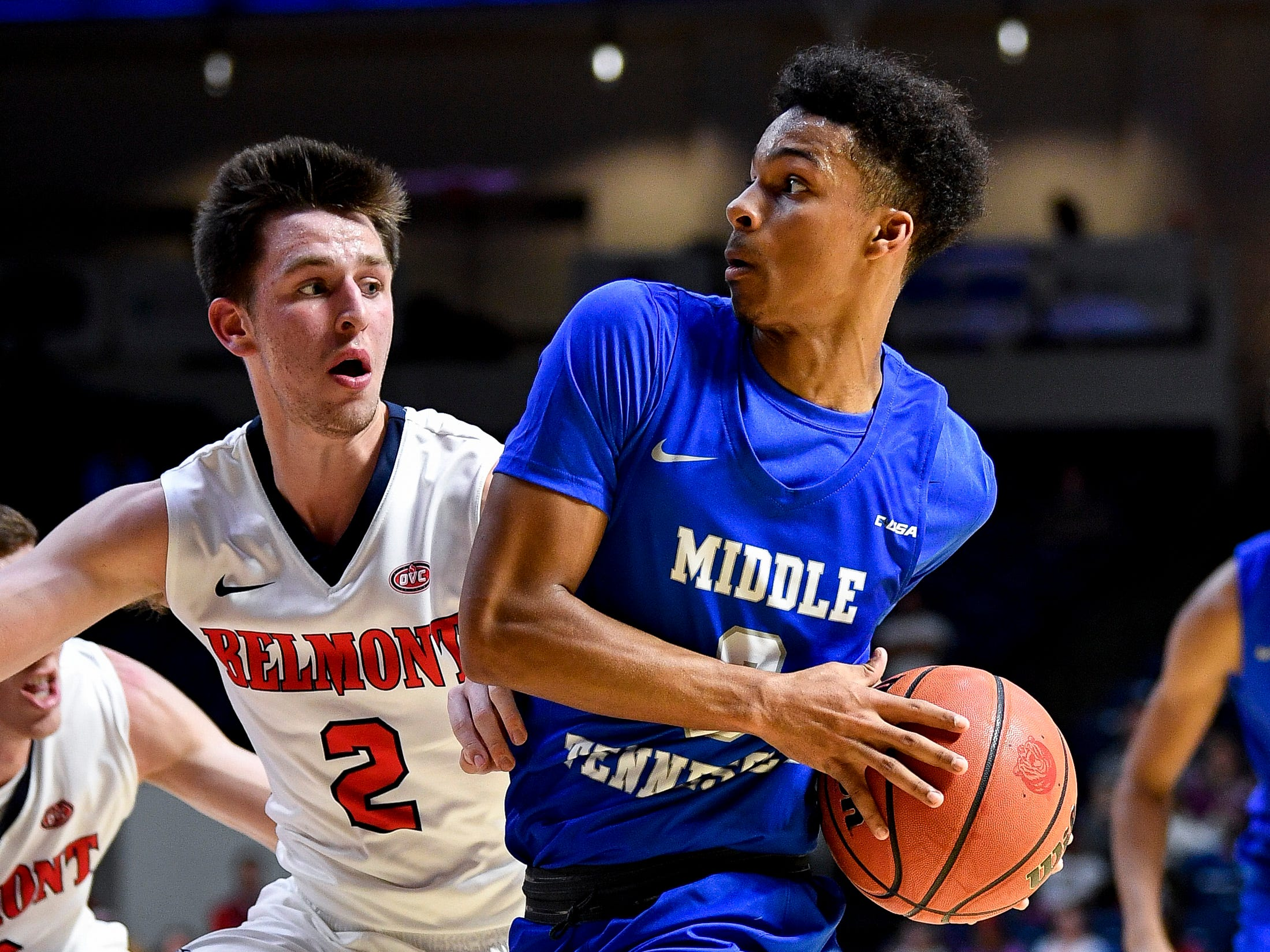 MTSU guard Donovan Sims (3) advances past Belmont guard Grayson Murphy (2) during the first half at the Curb Event Center Arena in Nashville, Tenn., Monday, Nov. 12, 2018.