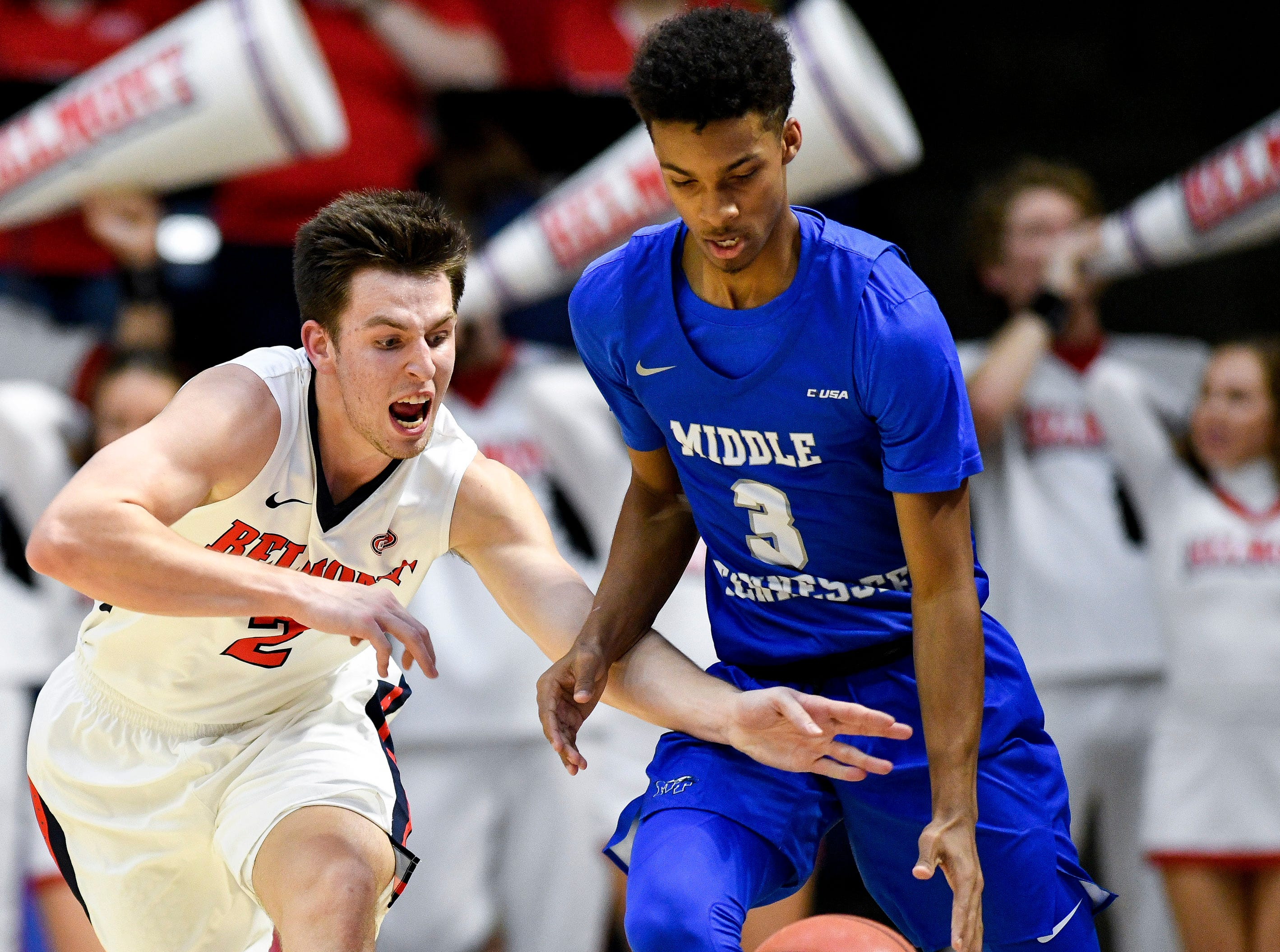 Belmont guard Grayson Murphy (2) fights for the ball with MTSU guard Donovan Sims (3) during the first half at the Curb Event Center Arena in Nashville, Tenn., Monday, Nov. 12, 2018.