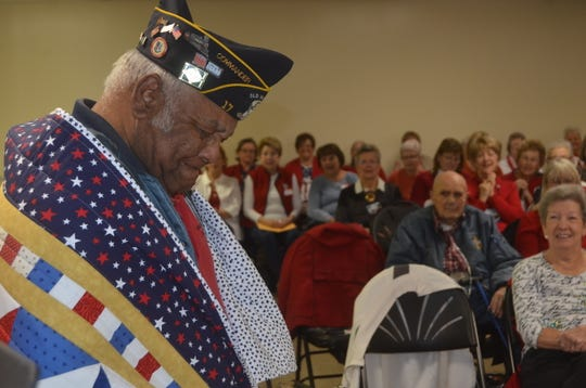 Curtis Malone, Army veteran and Commander of the American Legion Post 17, gets emotional thinking of his brother, a Vietnam veteran who died of Agent Orange, at the Lakeshore Quilters Guild's Quilt of Valor ceremony.