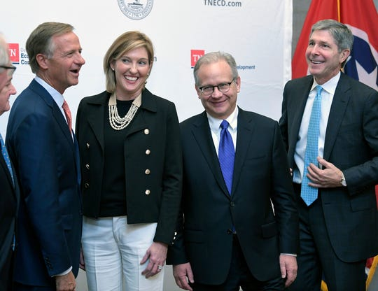 Gov. Bill Haslam,  Amazon's Holly Sullivan, Nashville Mayor David Briley and Tennessee Economic Development Commissioner Bob Rolfe gather together for a photograph after a  press conference as at the Old Supreme Court Chamber in the Tennessee State Capitol Tuesday, Nov. 13, 2018, in Nashville, Tenn.