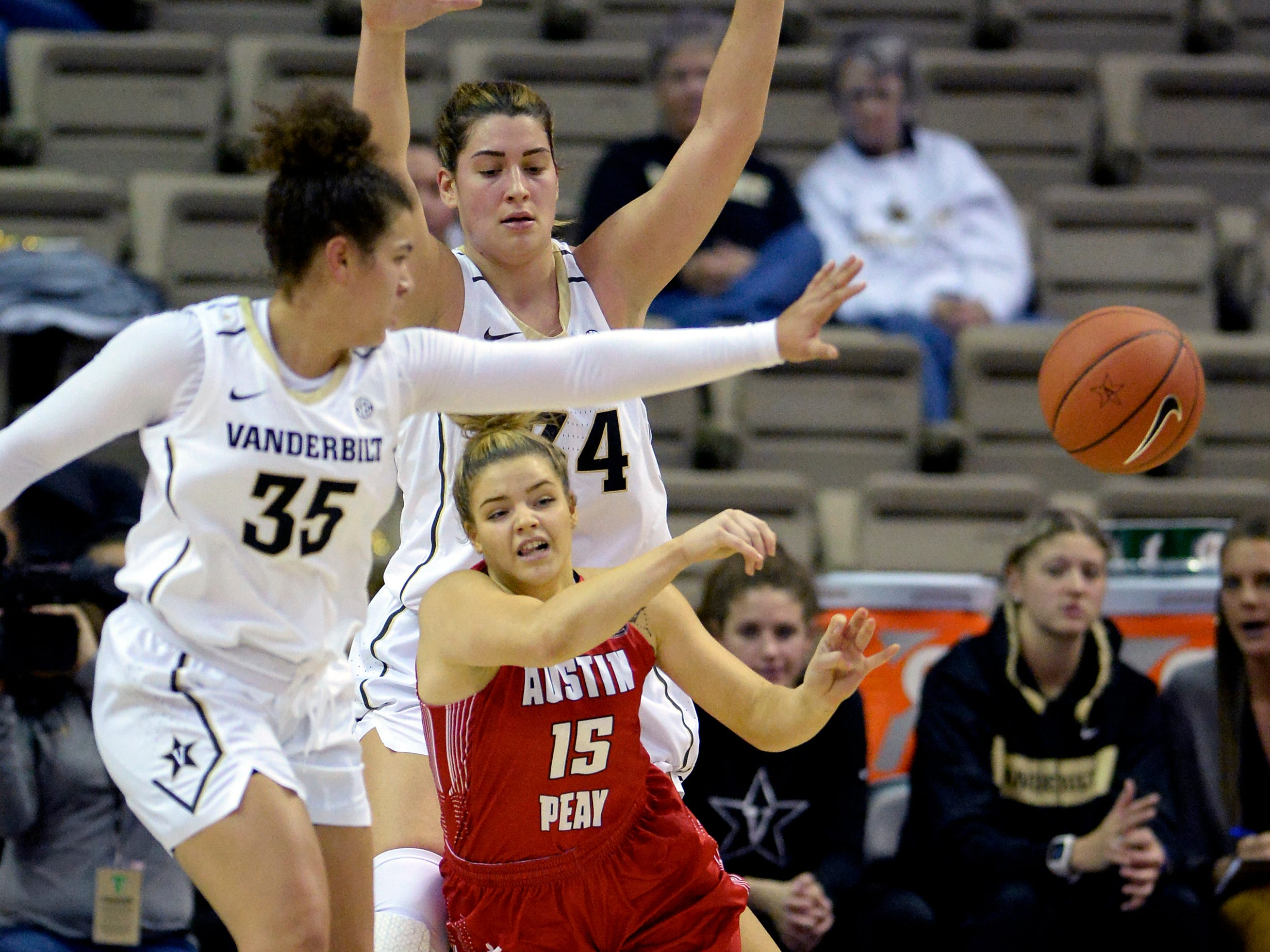 Austin Peay guard Kasey Kidwell (15) passes the ball as she is defended by Vanderbilt guard Kaleigh Clemons-Green (35) and forward Mariella Fasoula (34) during the first half of an NCAA college basketball game Monday, Nov. 12, 2018, in Nashville, Tenn.