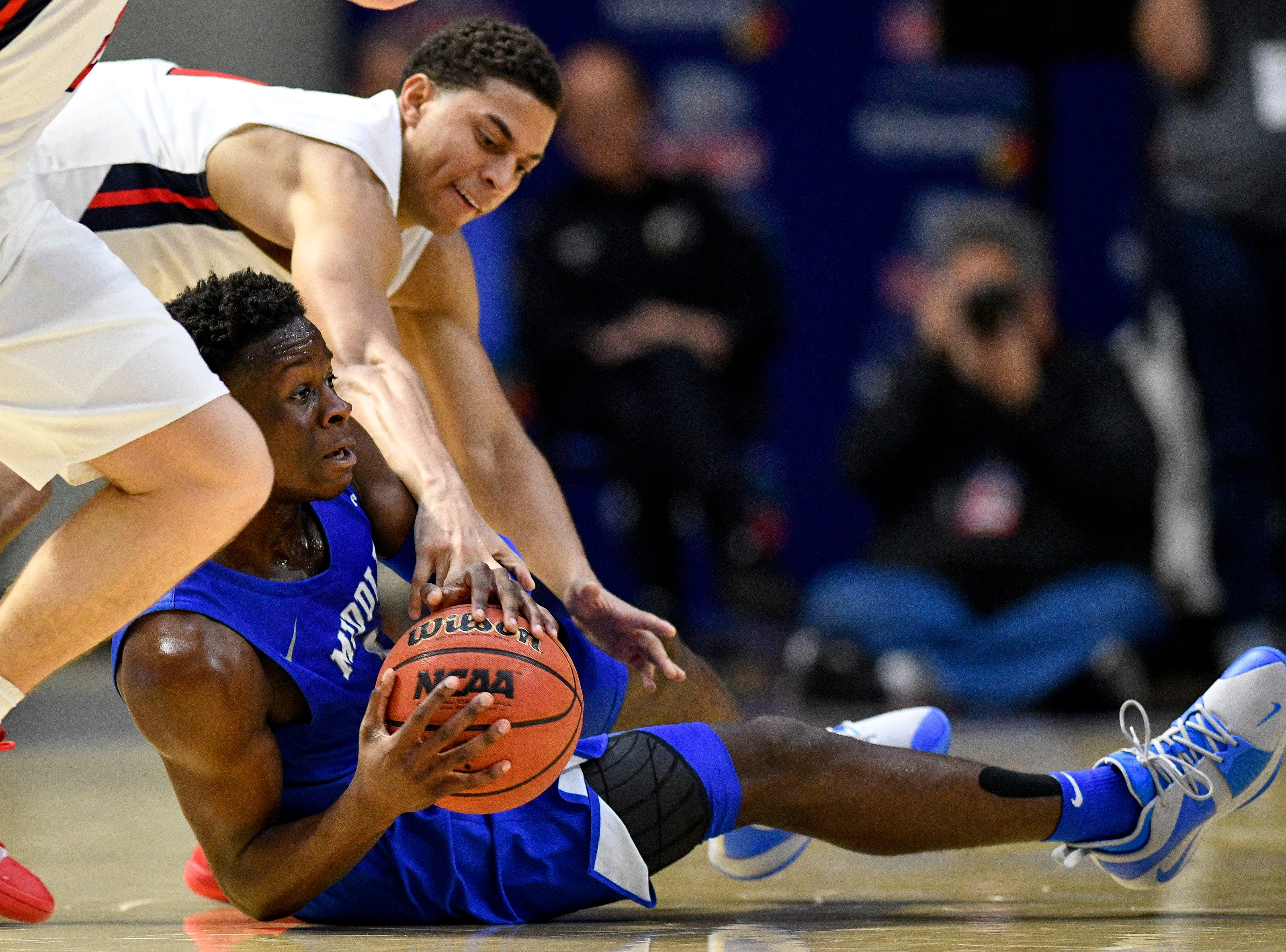 MTSU guard Junior Farquhar (1) battles Belmont guard Kevin McClain (11) during the second half at the Curb Event Center Arena in Nashville, Tenn., Monday, Nov. 12, 2018.