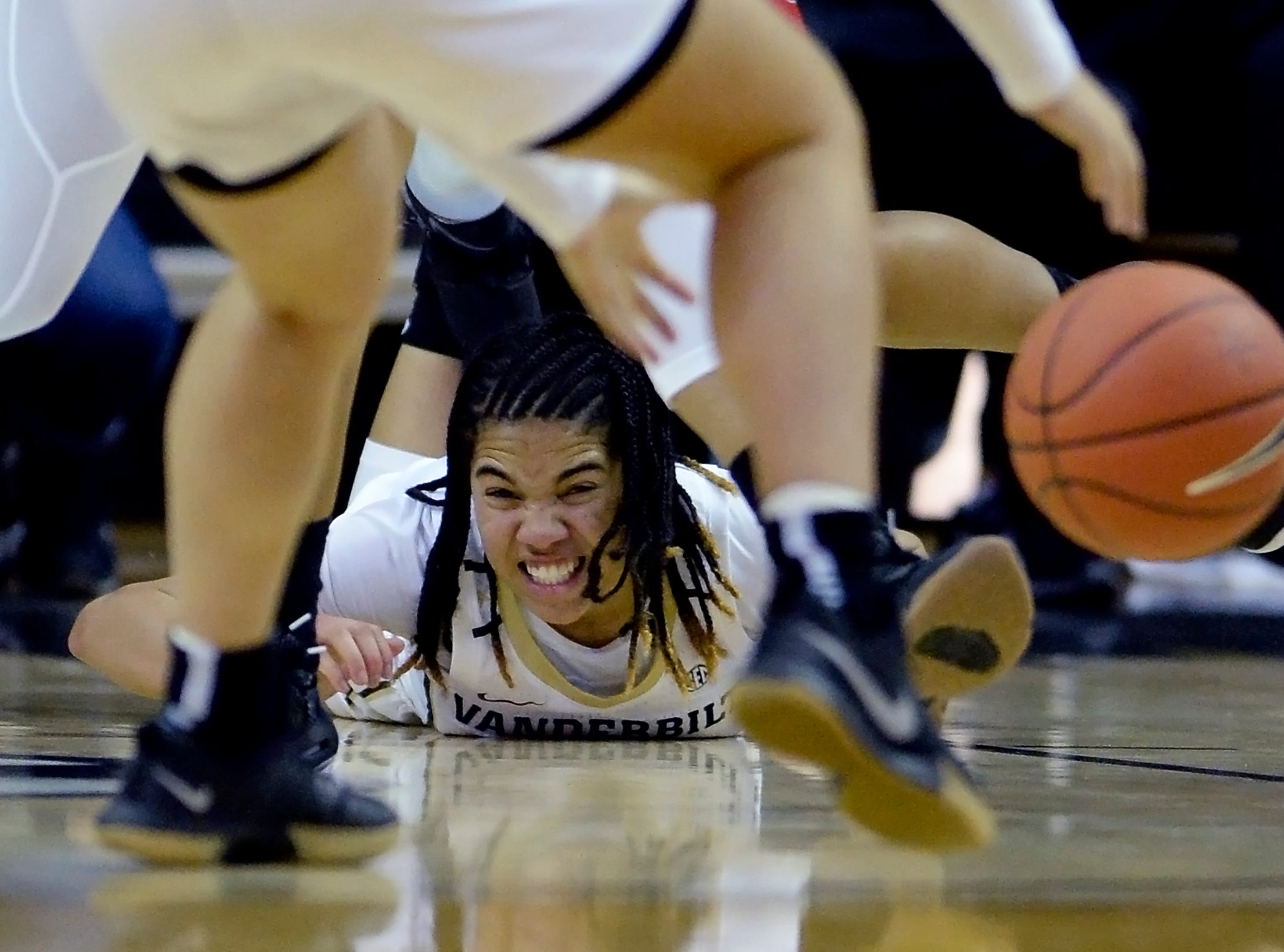 Vanderbilt guard Chelsie Hall (2) falls to the floor after passing the ball to guard Kaleigh Clemons-Green against Austin Peay during the second half of an NCAA college basketball game Monday, Nov. 12, 2018, in Nashville, Tenn. Vanderbilt won 99-70.