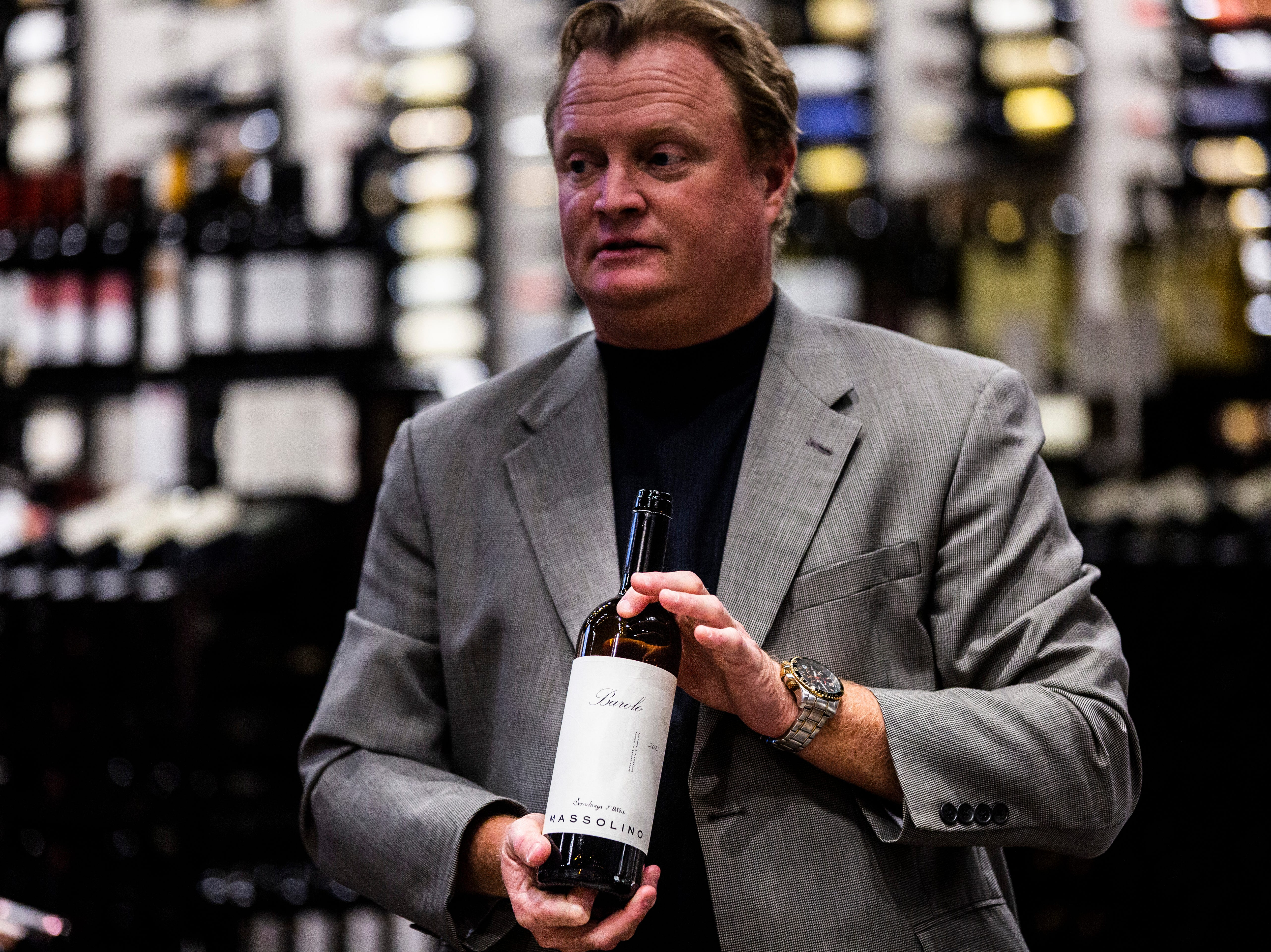 John J. Burke, from Break Thru Beverage Group, reveals the bottle of red wine that Eric Blais, the wine director and certified sommelier at USS Nemo, attempted to identify during a blind taste-test in the Somms Showdown at The Cave Bistro & Wine Bar in Naples on Tuesday, Nov. 13, 2018.