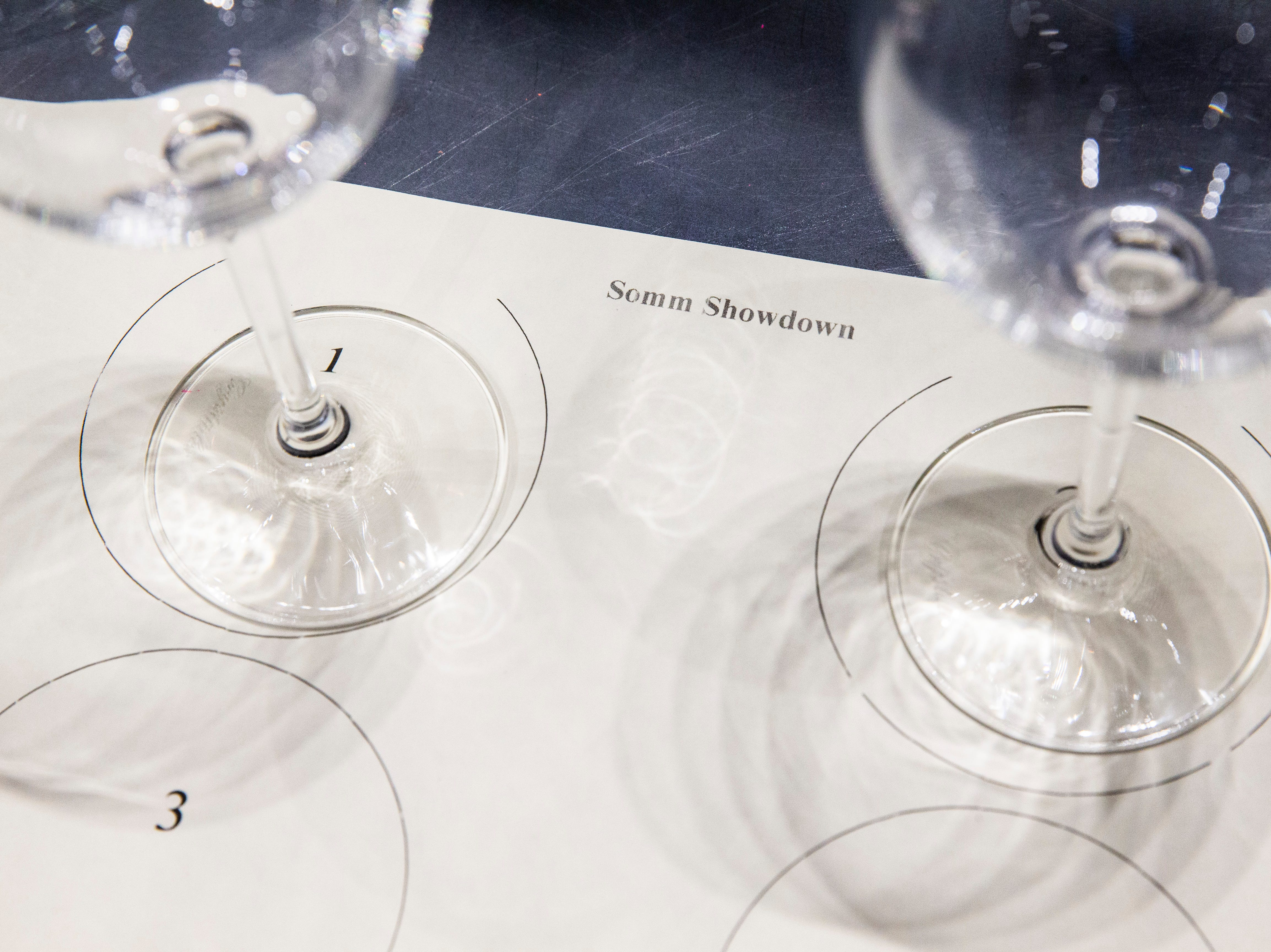 Sheets are numbered so local sommeliers can participate in a blind taste-test of two red and two white wines during the Somms Showdown, organized by Break Thru Beverage Group, at The Cave Bistro & Wine Bar in Naples on Tuesday, Nov. 13, 2018.