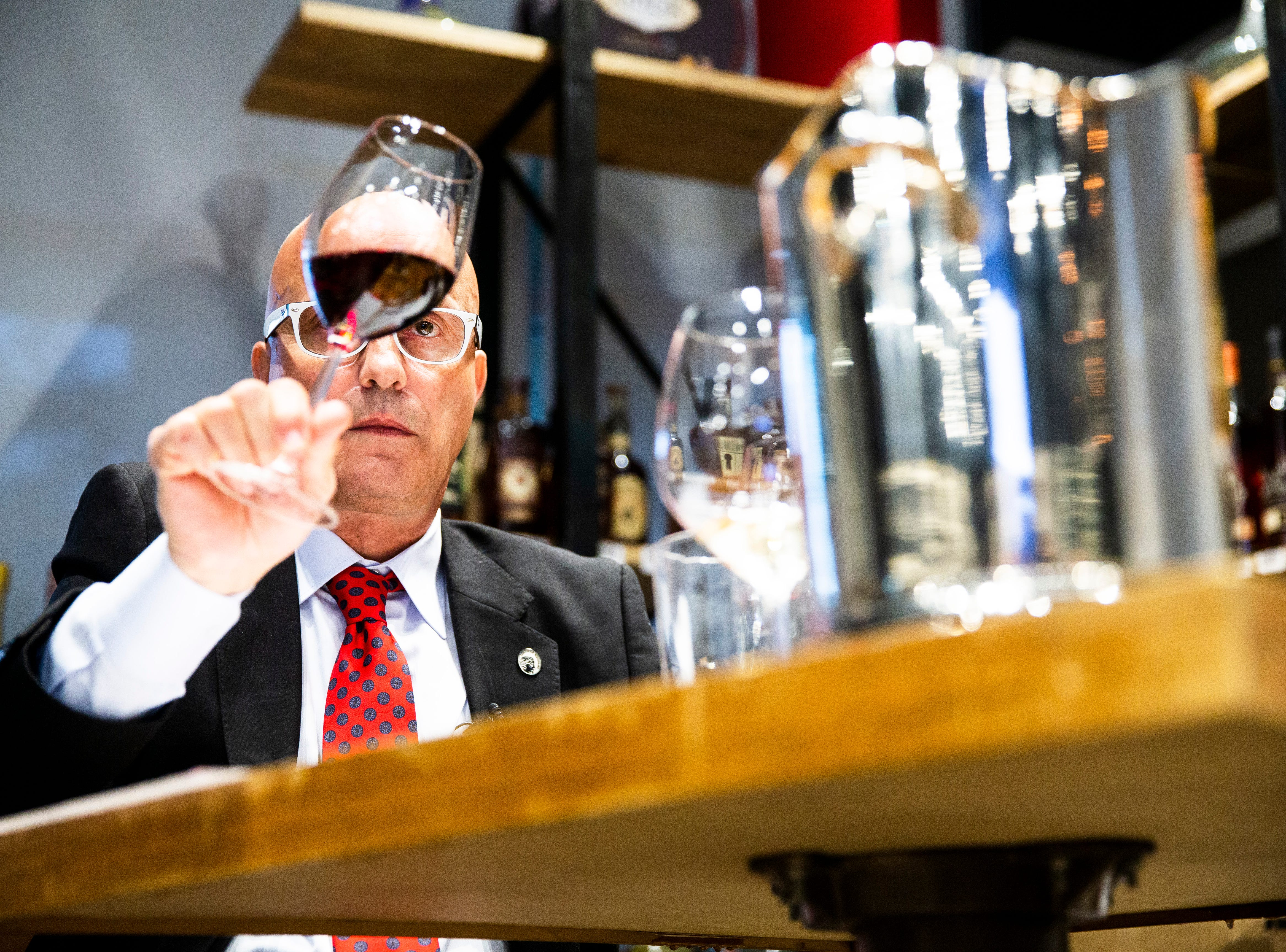 Eric Blais, the wine director and certified sommelier at USS Nemo, competes in the Somms Showdown, organized by Break Thru Beverage Group, at The Cave Bistro & Wine Bar in Naples on Tuesday, Nov. 13, 2018. The seven-week tournament challenges local sommeliers to identify two red and two white wines in a blind taste-test as a live audience watches on. Winners advance each week until the top wine expert is crowned.