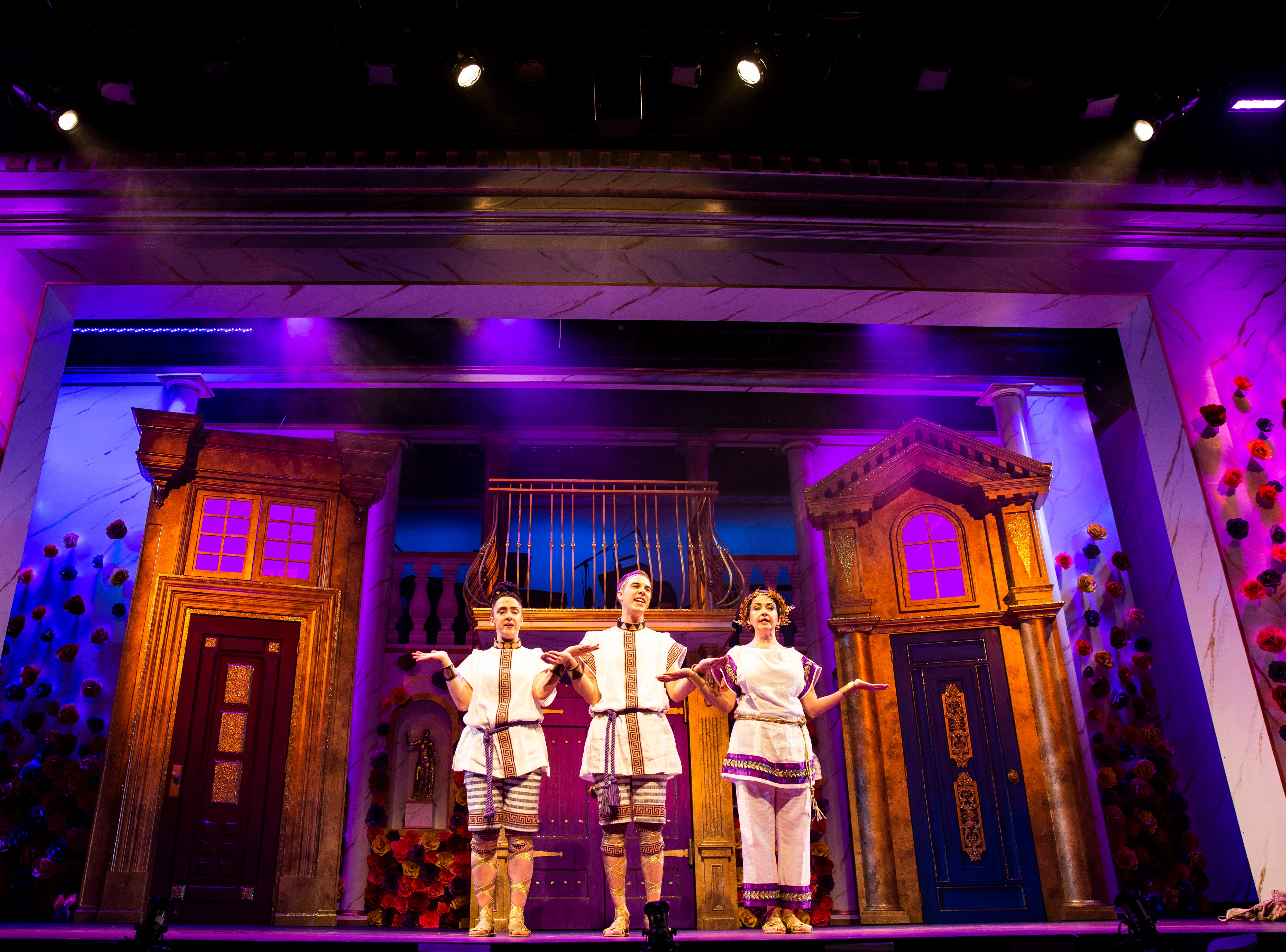 """Kristen Mengelkoch, from left, John Wascavage and Michele Ragusa rehearse a scene for Gulfshore Playhouse's upcoming production of """"A Funny Thing Happened on the Way to the Forum"""" at The Norris Center in Naples on Tuesday, Nov. 13, 2018."""