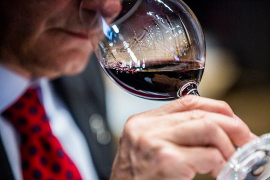 Eric Blais, the wine director and certified sommelier at USS Nemo, smells a red wine during the Somms Showdown, organized by Break Thru Beverage Group, at The Cave Bistro & Wine Bar in Naples on Tuesday, Nov. 13, 2018.