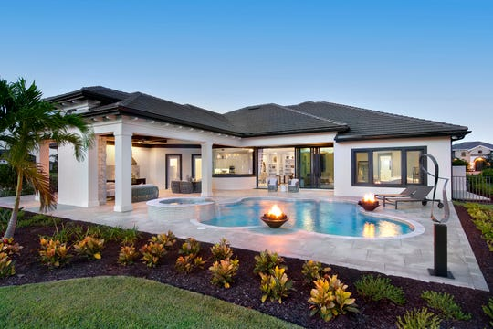 The Normandy II by Stock Signature Homes is one of two furnished models available to tour at Quail West.