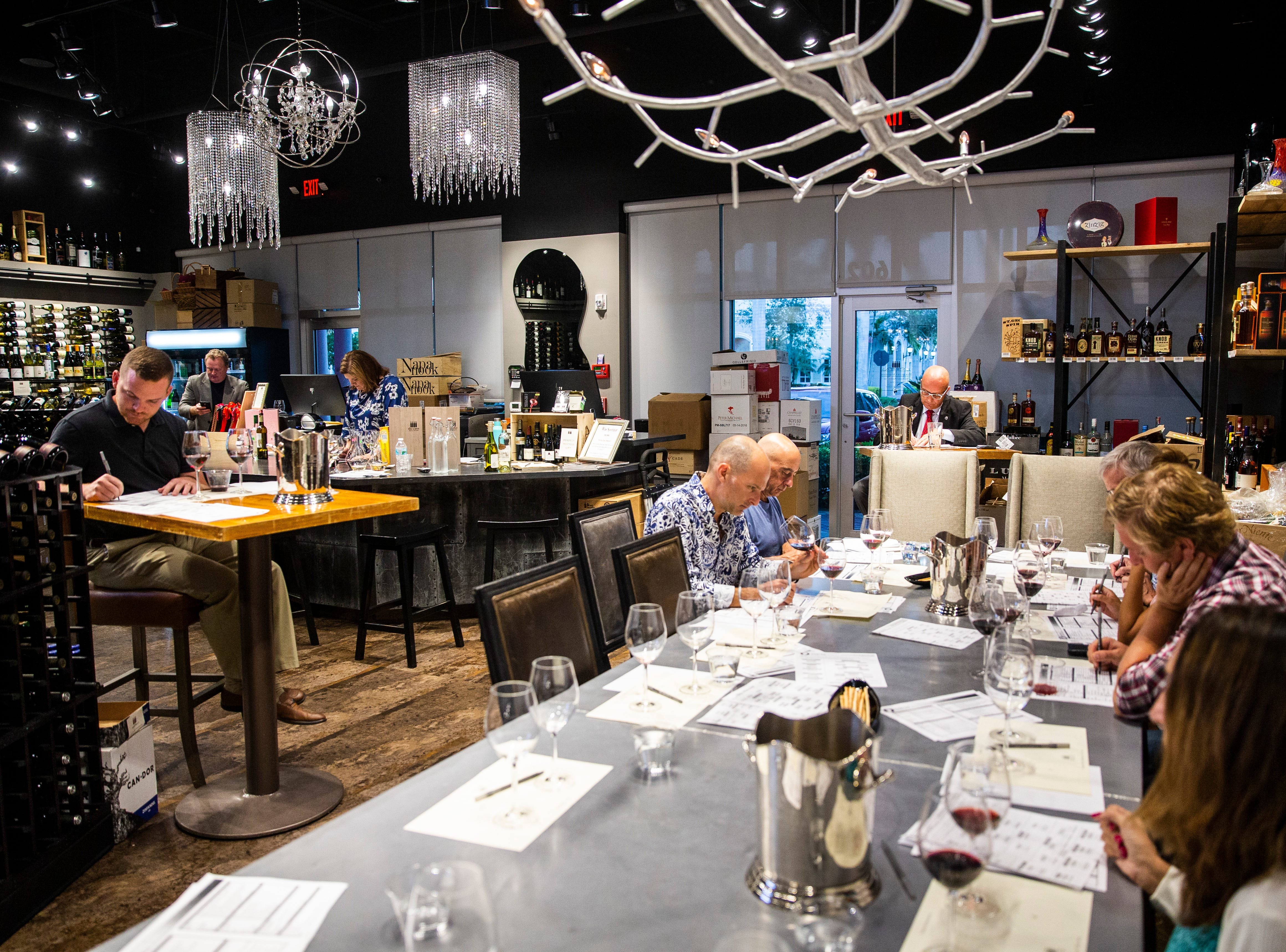 Eric Blais, the wine director and certified sommelier at USS Nemo, competes in the Somms Showdown, organized by Break Thru Beverage Group, at The Cave Bistro & Wine Bar in Naples on Tuesday, Nov. 13, 2018.