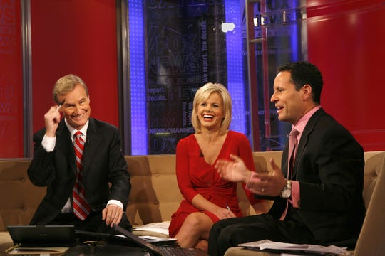 "Co-hosts Steve Doocy, left, Gretchen Carlson and Brian Kilmeade on ""Fox & Friends,"" Fox News' morning show."