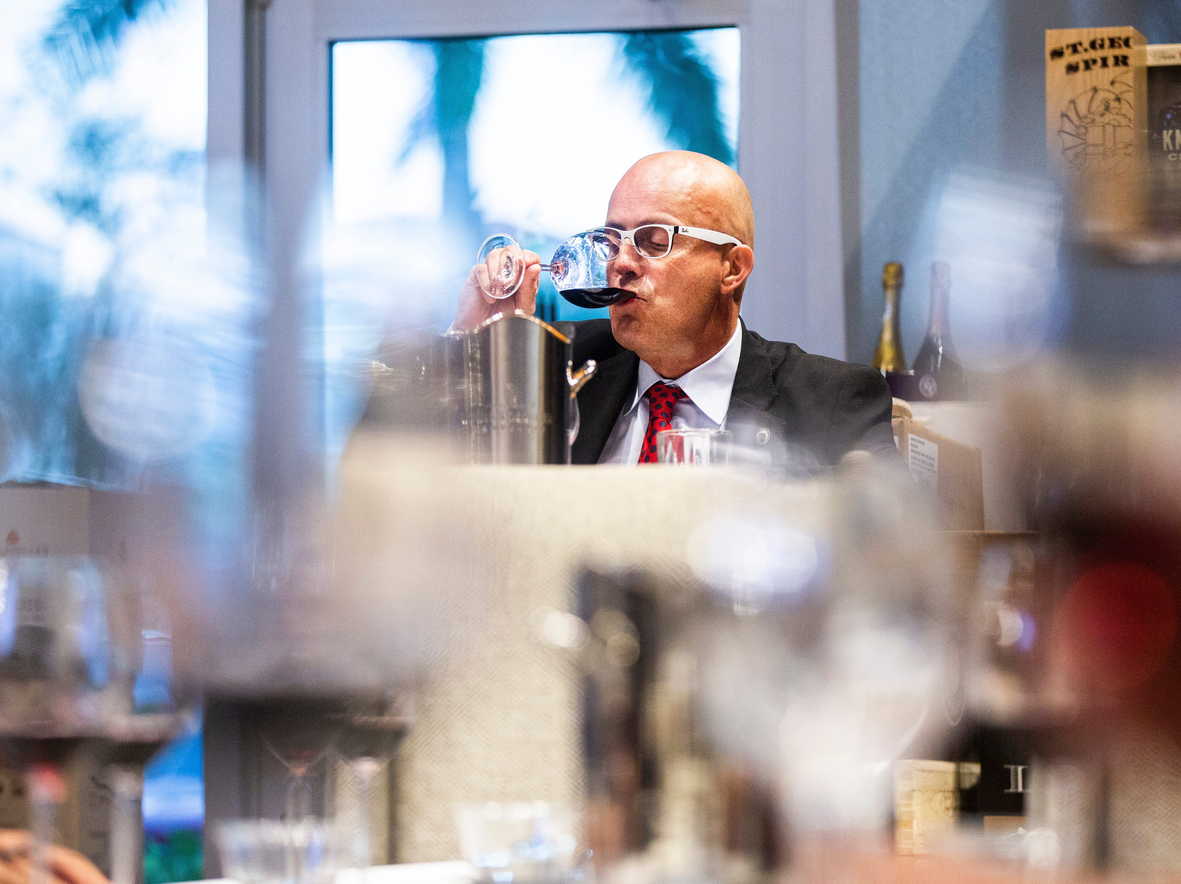 Eric Blais, the wine director and certified sommelier at USS Nemo, tastes a red wine while competing in the Somms Showdown, organized by Break Thru Beverage Group, at The Cave Bistro & Wine Bar in Naples on Tuesday, Nov. 13, 2018.
