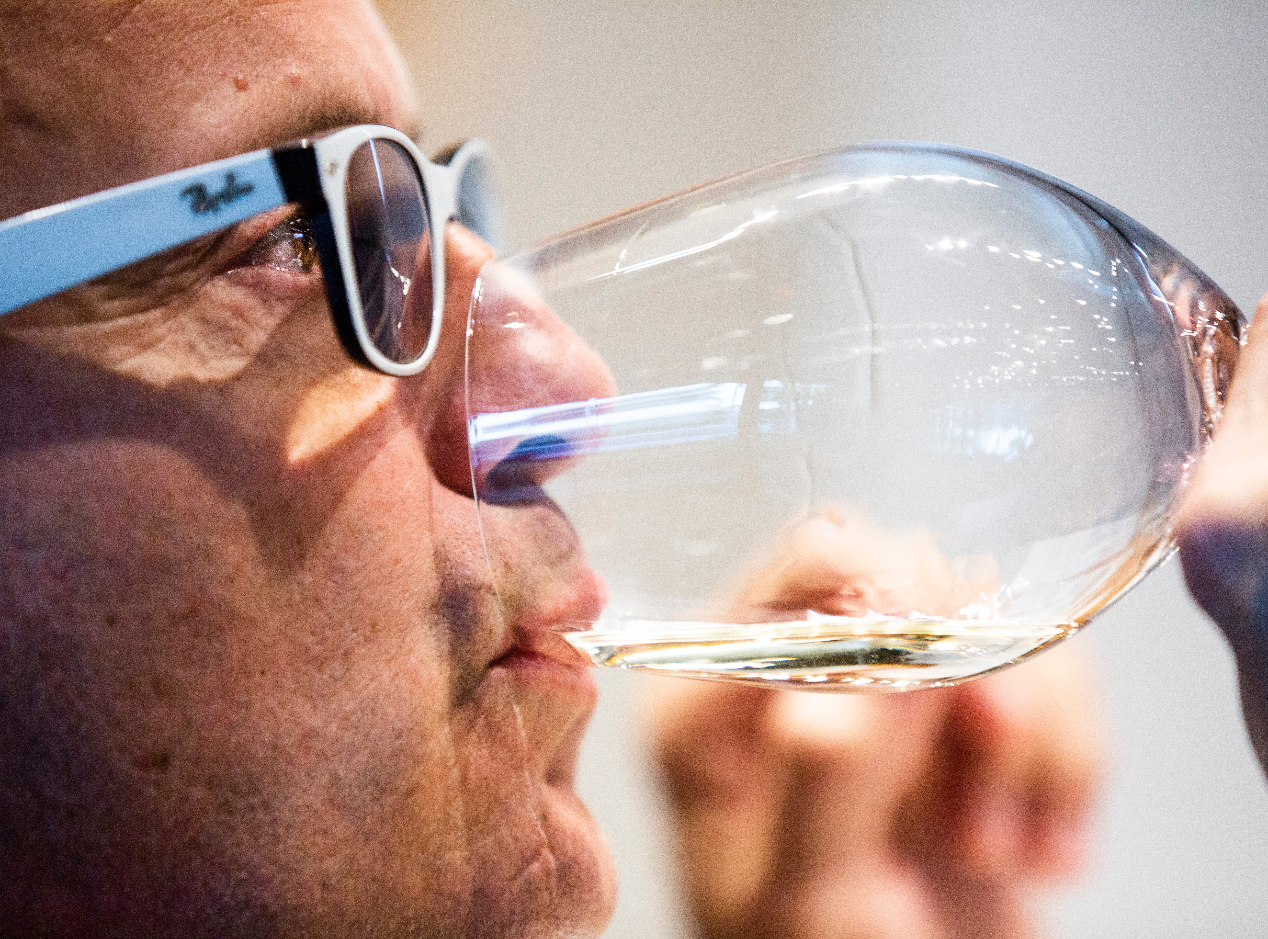 Eric Blais, the wine director and certified sommelier at USS Nemo, tastes a white wine during the Somms Showdown, organized by Break Thru Beverage Group, at The Cave Bistro & Wine Bar in Naples on Tuesday, Nov. 13, 2018.
