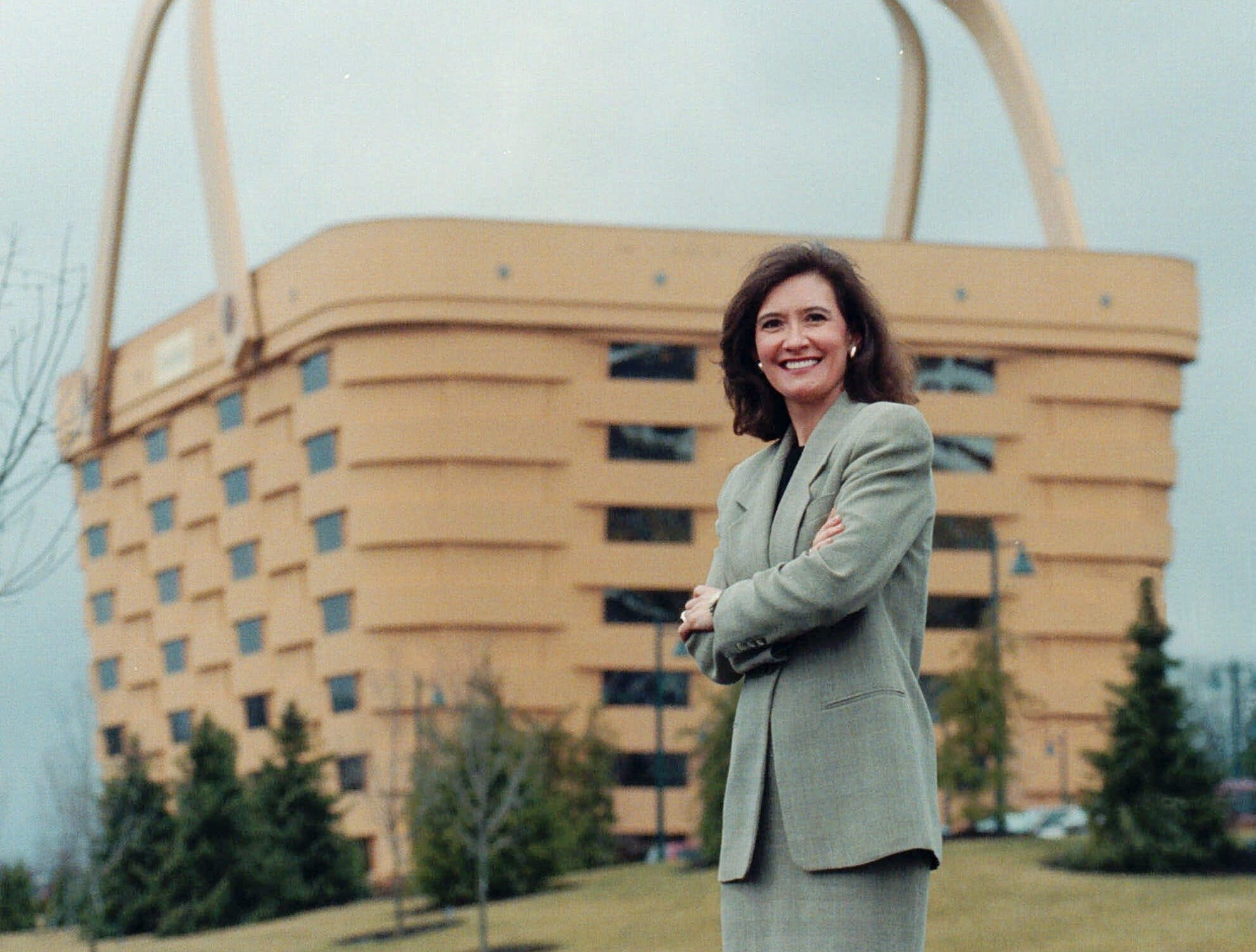 Tami Longaberger president and chief executive of The Longaberger Company stands outside the basket-shaped corporate office building in Newark Ohio Tuesday Feb. 2 1999. The company which her father started in 1973 with five basket weavers employed thousands of workers and produced millions of hand woven baskets a year. (AP Photo/File Chris Kasson)