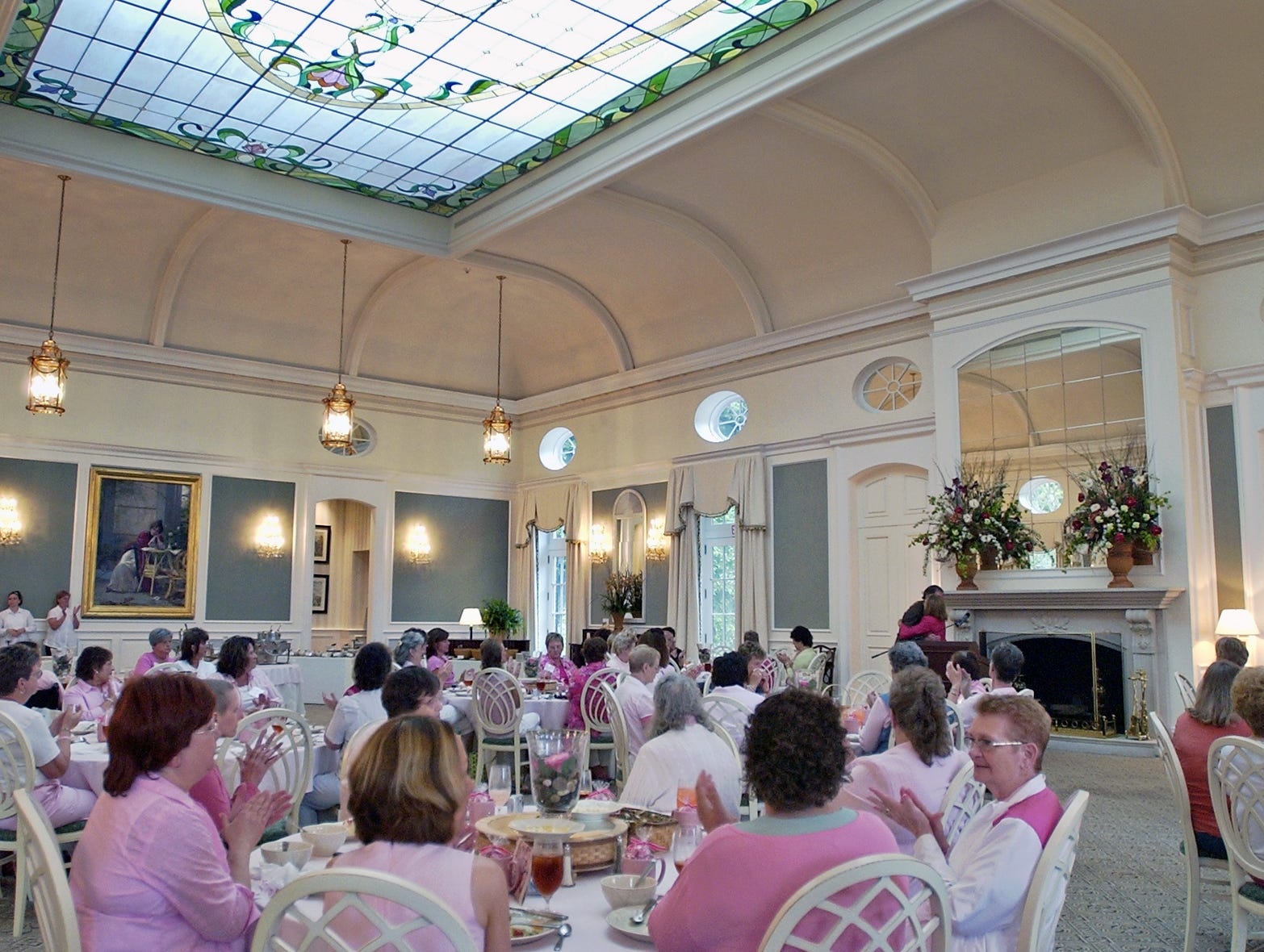 A luncheon is held in honor of breast cancer survivors Wednesday, July 12, 2006, at Eschman Meadows, the home of Tami Longaberger, CEO and chairman of Longaberger company.