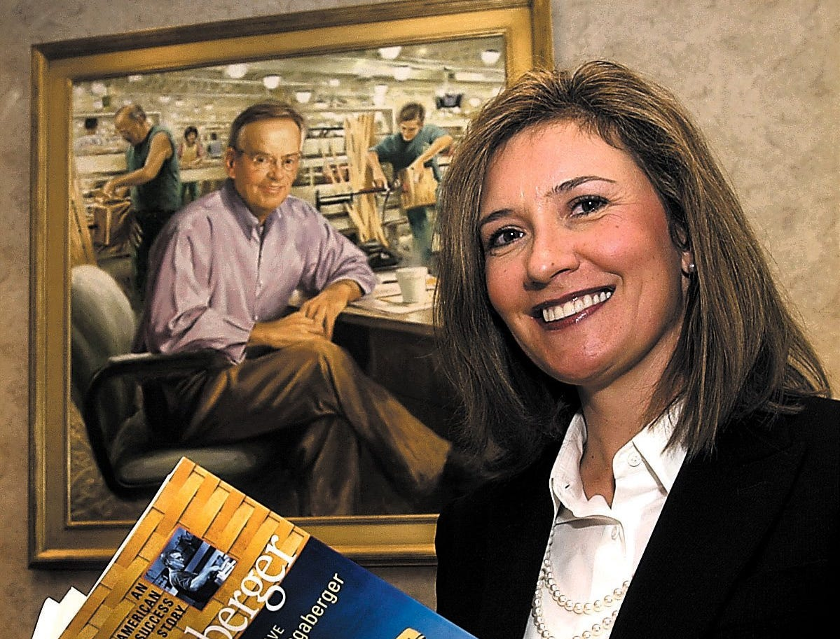 """Tami Longaberger worked closely with her father, Dave Longaberger (in portrait behind), on the book """"Longaberger: An American Success Story."""" The book focuses on the enduring history of the company with advice to entrepreneurs on the keys to a successful business."""
