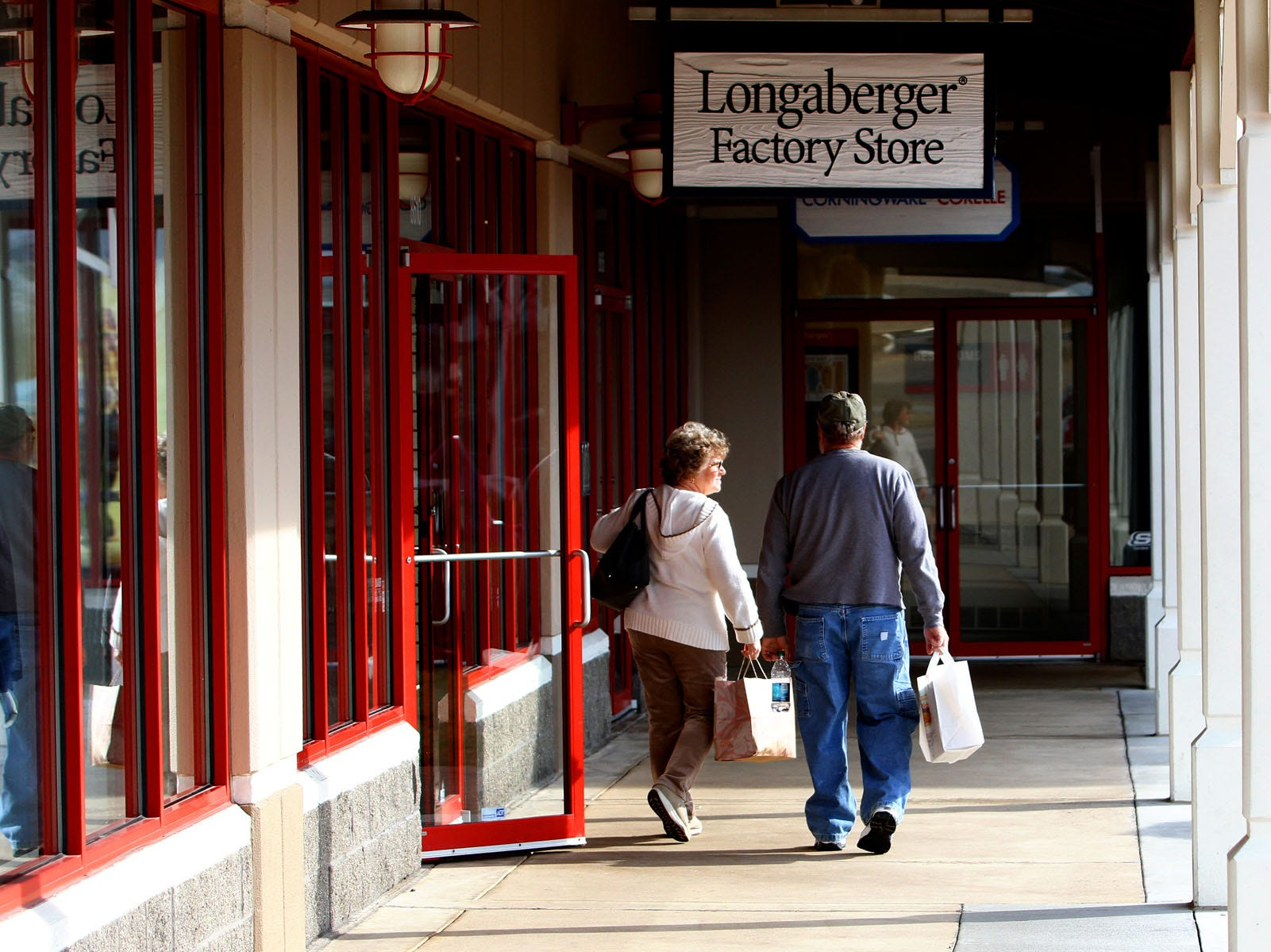 Doris and Mike Smith of Teays Valley, West Virginia leave after shopping at the Longaberger Factory Store in the Tanger Outlet Center in Jeffersonville, Ohio on Wednesday, Feb. 01, 2012.
