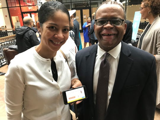 Migdelis Perez and Floyd Townsend, of Newark accounting firm Floyd D. Townsend & Associates, showing the smartphone app they have developed to help small businesses with their bookkeeping, at the StartupNewark tech conference Thursday