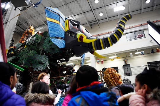 Third graders from the Robert L. Craig Elementary School in Moonachie get a behind-the-scenes tour at the Macy's Parade Studio, featuring a giant elephant on the Kalahari Resorts and Conventions float, on Tuesday, Nov. 13, 2018.