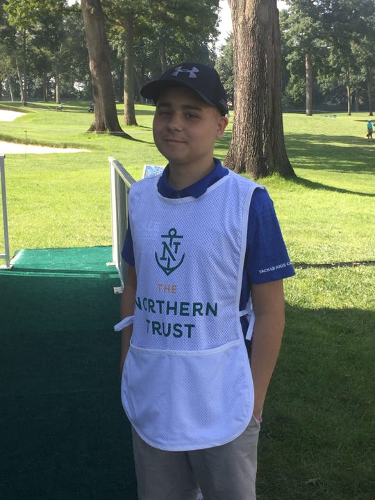 Dylan Catanese, 17, of Saddle Brook, serves as a flag bearer at The Northern Trust in August. Catanese was diagnosed with Acute Lymphoblastic Leukemia earlier this year.
