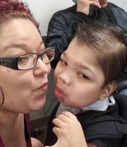 "Mary Arroyo of the Bronx with her son, Ismael Velez, 15. ""I know they have been getting bashed,"" she said of the staff at the Wanaque center, ""and I think it's really hard for them because they try their best."""