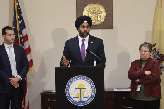 New Jersey Attorney General Gurbir Grewal announced that the state filed a lawsuit against Janssen Pharmaceuticals inc. on Tuesday morning. The state alleges that Janssen deceived consumers about the dangers of two of its opioids, which have high potential for abuse. He was accompanied by Paul R. Rodríguez, left, acting director of community affairs, and Sharon M. Joyce, director of NJ CARES (Coordinator of Addiction Responses and Enforcement Strategies). Tuesday, November 13, 2018.