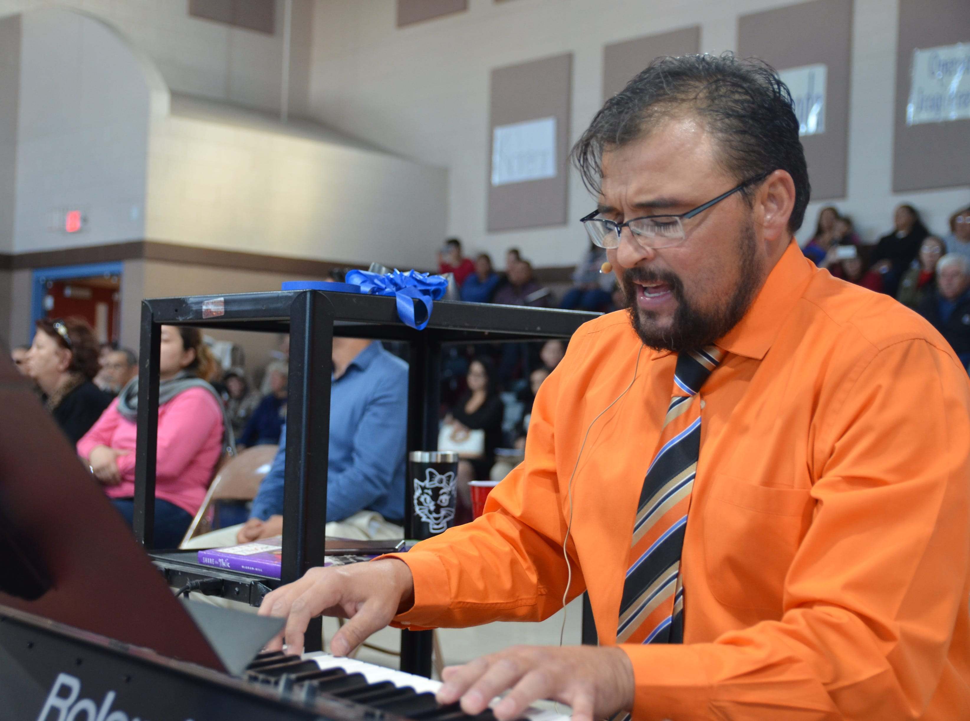 Music teacher Brandon Perrault of Ruben S. Torres Elementary School plays and sings along with students.