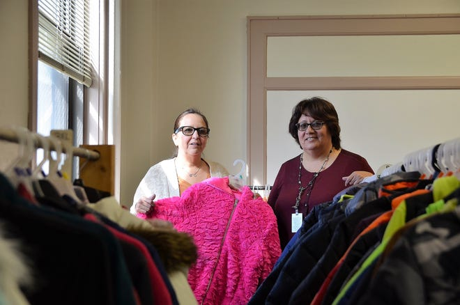 Left, Christy Trejo and Olivia Paez of Luna County Coats for Kids stand in the midst of their inventory of coats. Trejo and Paez are asking the public to donate coats or money to meet their goal of collecting 600 winter garments this year for DPS students in need.