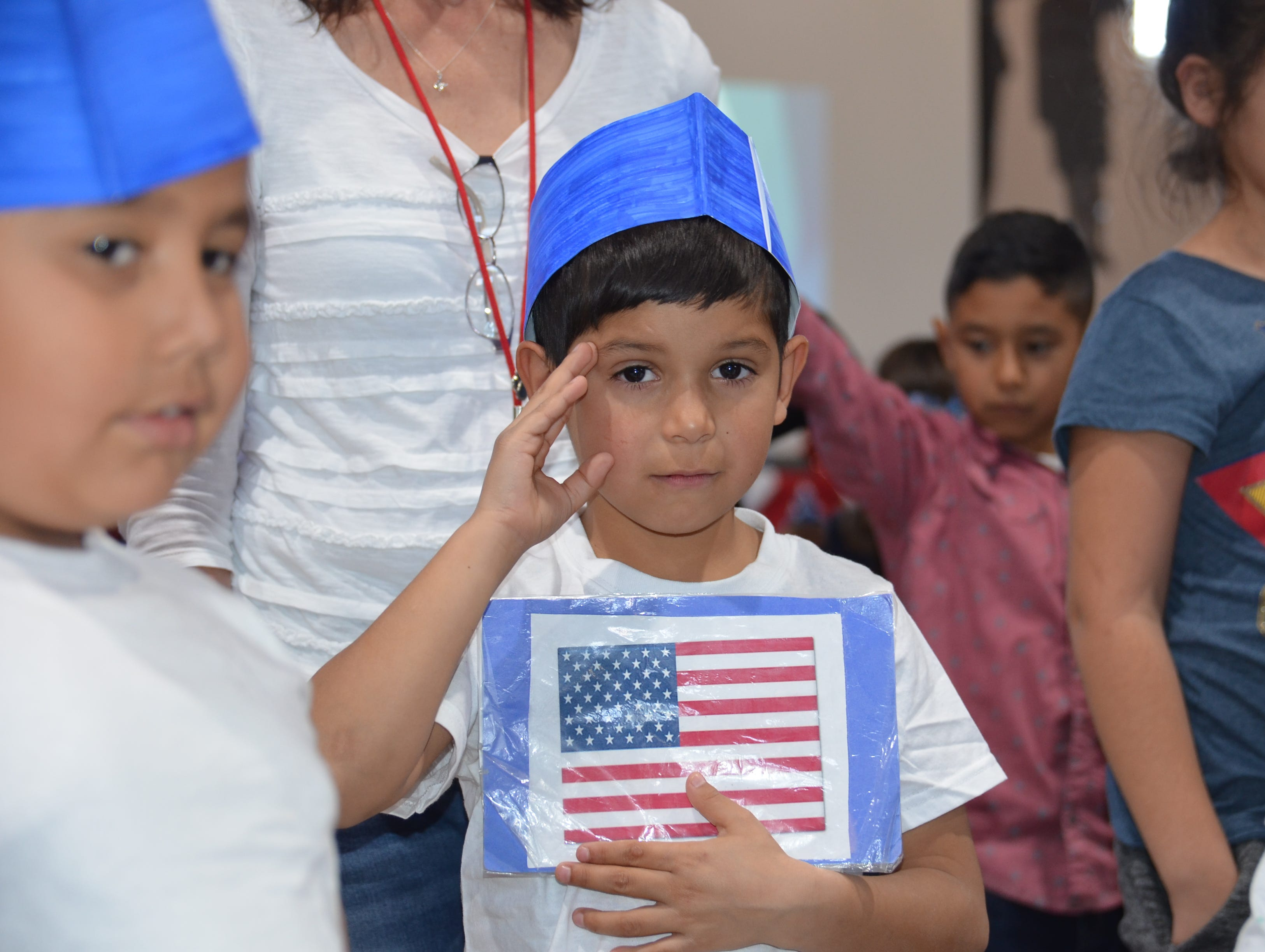 Sebastian Amaya, 6, of Ms. Nivea Aguirre's first grade class give the salute.