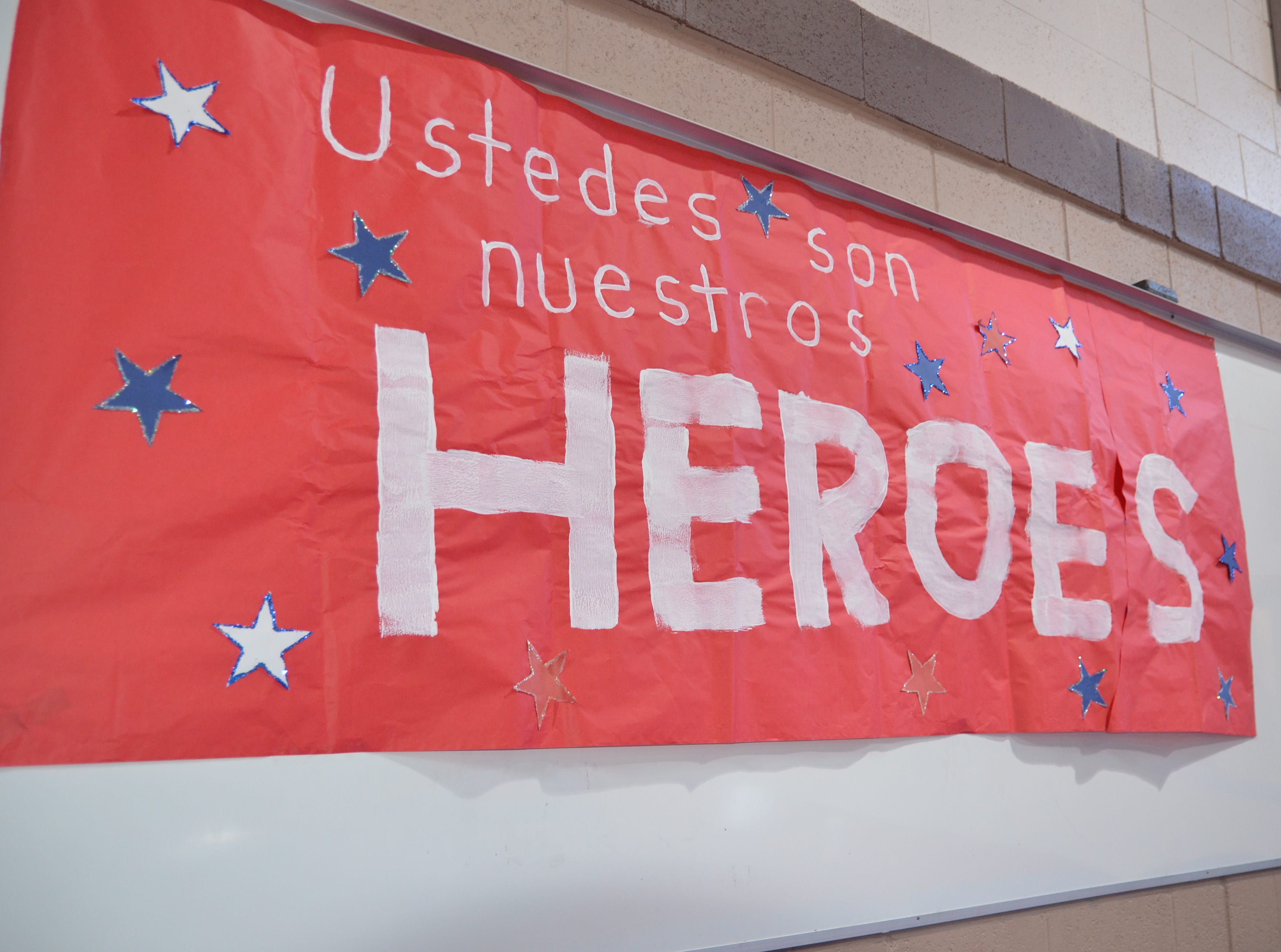 A sign that reads: Ustedes son nuestros heroes (You are our heroes). Hung in Ruben S. Torres Elementary School auditorium.