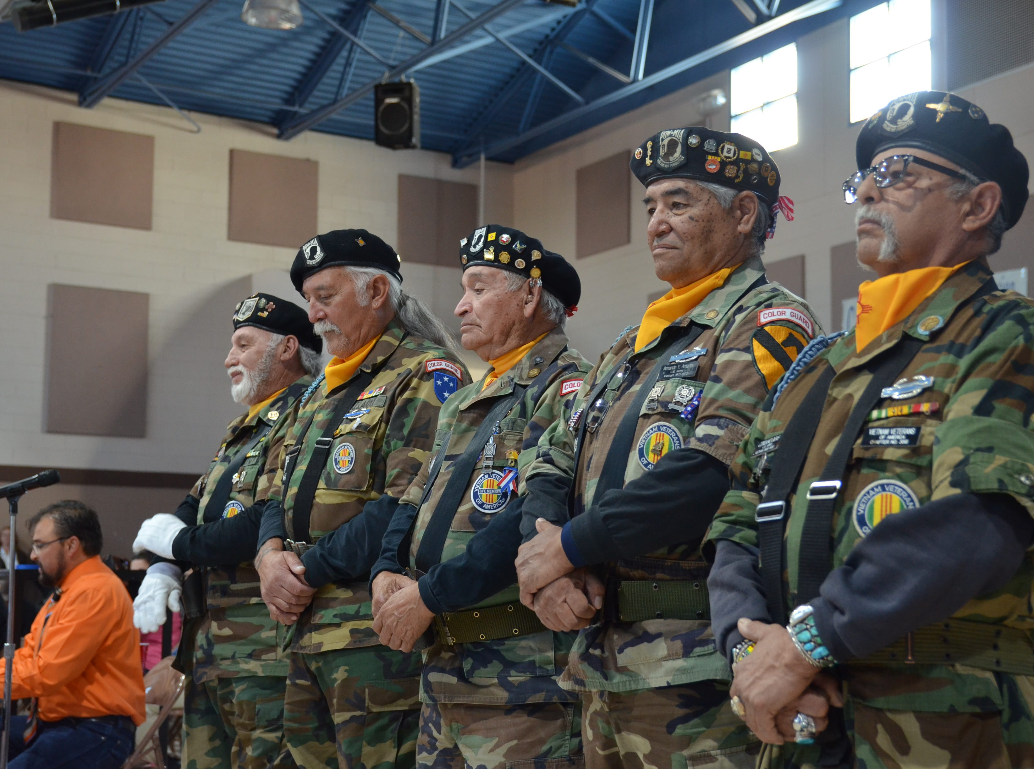 Left, Veterans Henry Morales, Jose Ray, Pablo Ortega Madrid, Armando Amador and Cipriano Ogas stand for God Bless the USA song performed by all school grades from Ruben S. Torres Elementary School.