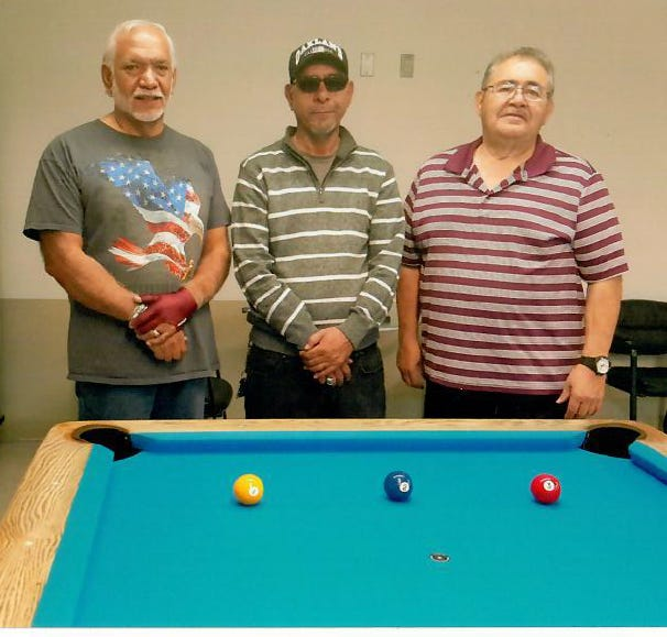 Winners of the Munson Senior Center's October 8-ball billiards tournament pictured from left: Henry Telles, first place; Carlos Hernandez, second place; John Arsola, third place.